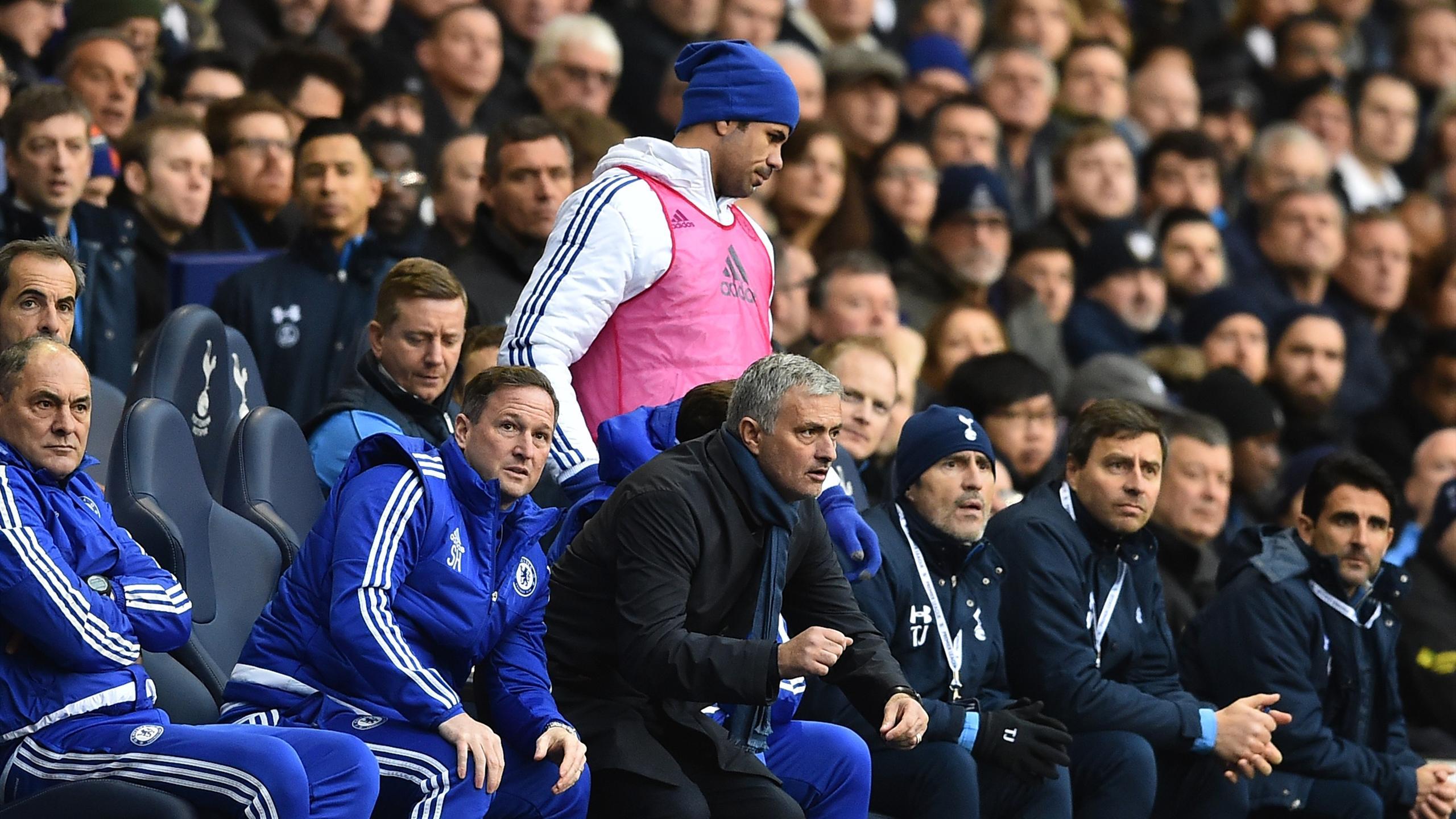 Chelsea's Brazilian-born Spanish striker Diego Costa (top) passes Chelsea's Portuguese manager Jose Mourinho