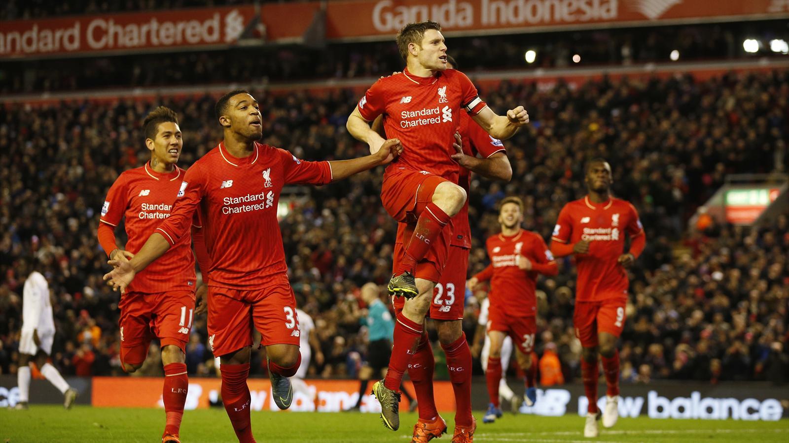 James Milner celebrates his opener for Liverpool