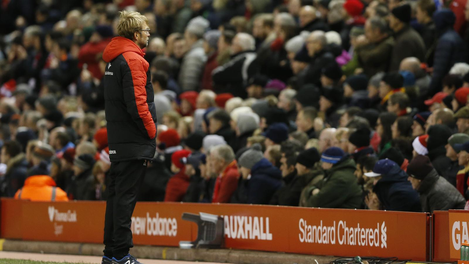 Liverpool manager Jurgen Klopp looks away as James Milner scores from the penalty spot