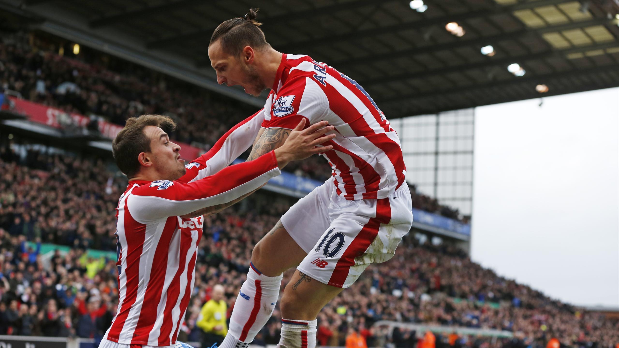 Marko Arnautovic celebrates with Xherdan Shaqiri after scoring the first goal for Stoke City
