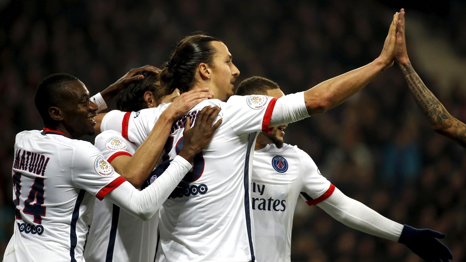 Paris St Germain's Zlatan Ibrahimovic (C) reacts after scoring against Nice