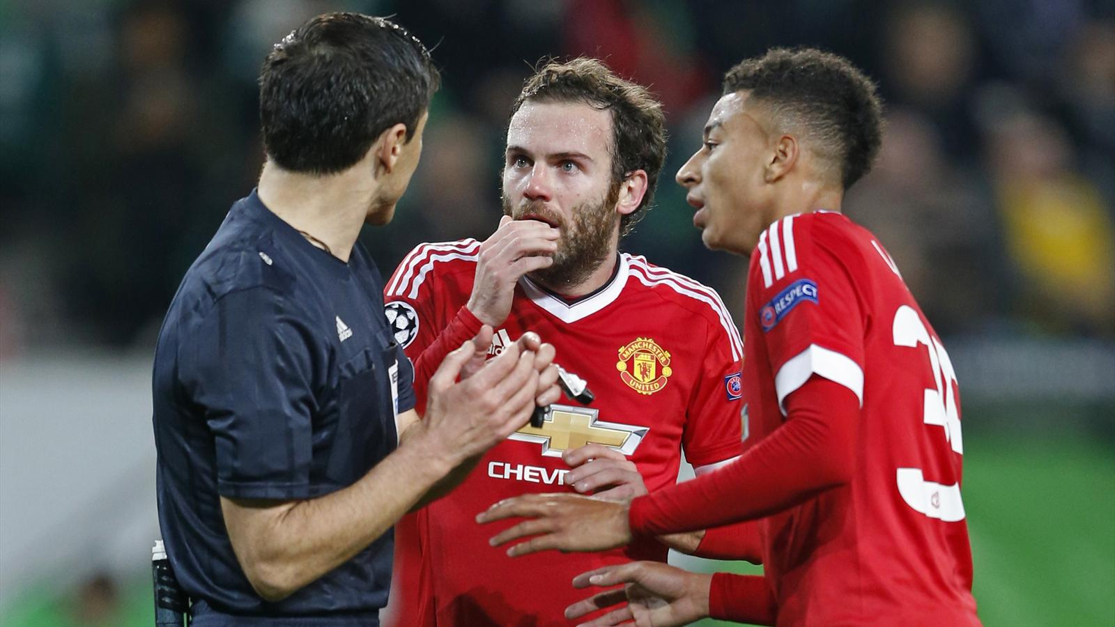 Manchester United's Jesse Lingard and Juan Mata remonstrate with referee Milorad Mazic after he disallowed a goal