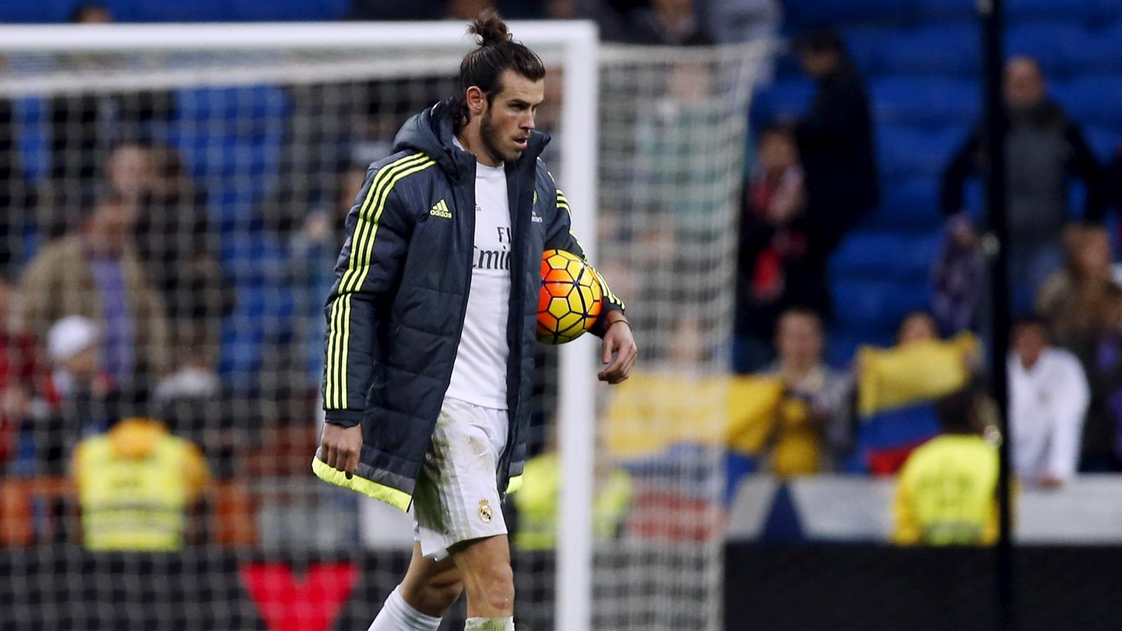 Real Madrid's Gareth Bale holds the ball after the match