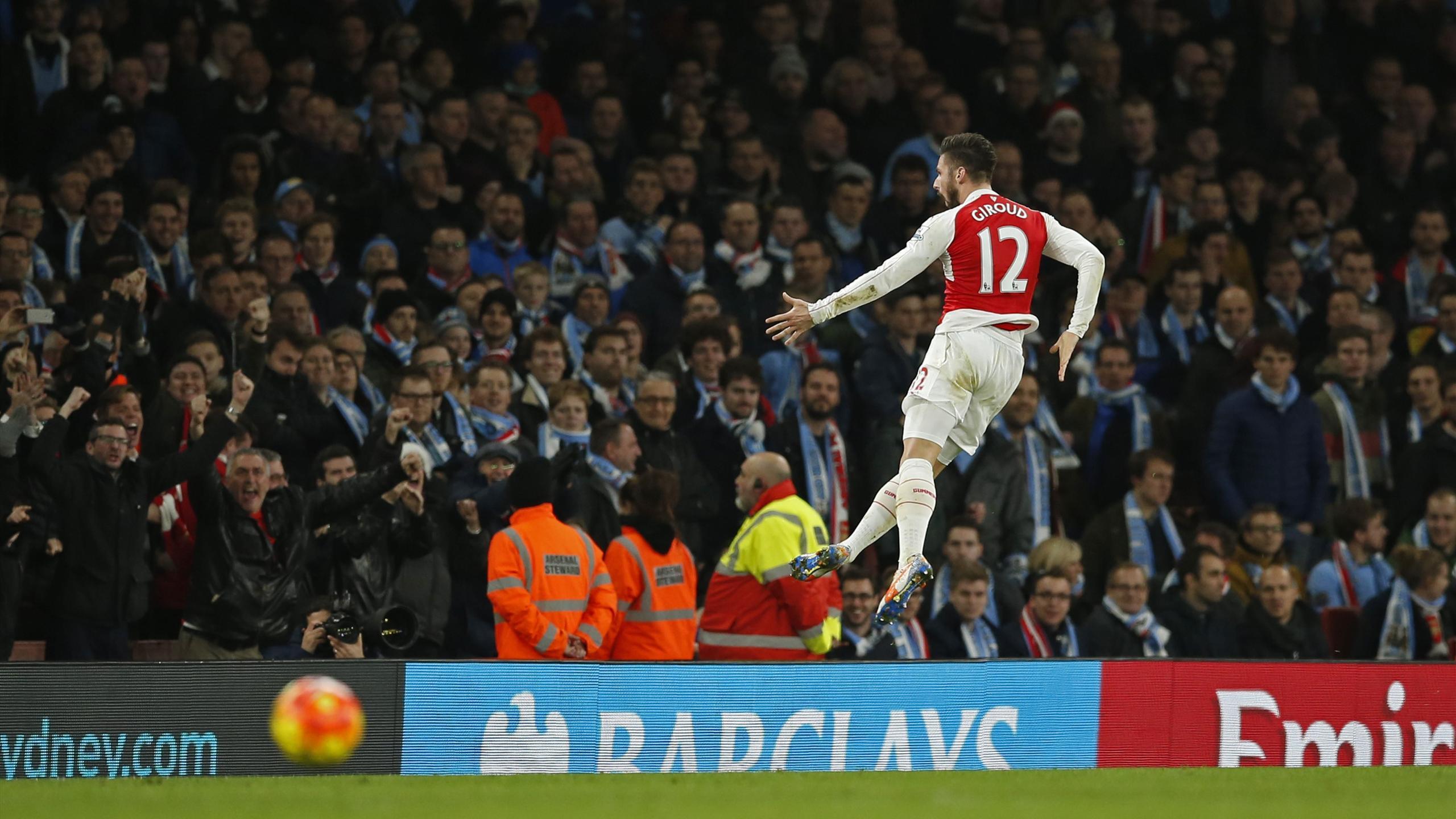Olivier Giroud celebrates scoring the second goal for Arsenal.