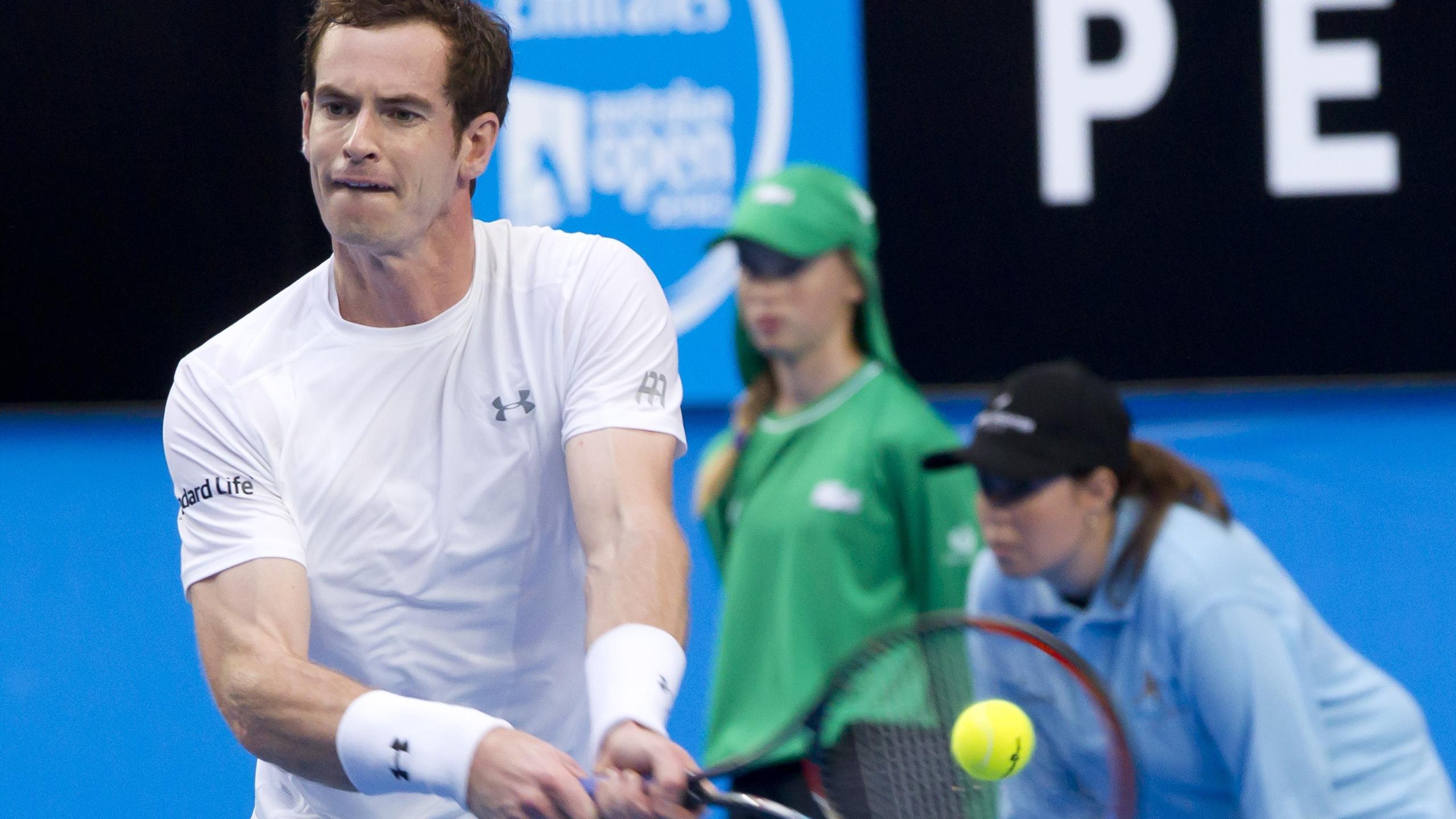 Andy Murray hits a return against Kenny de Schepper