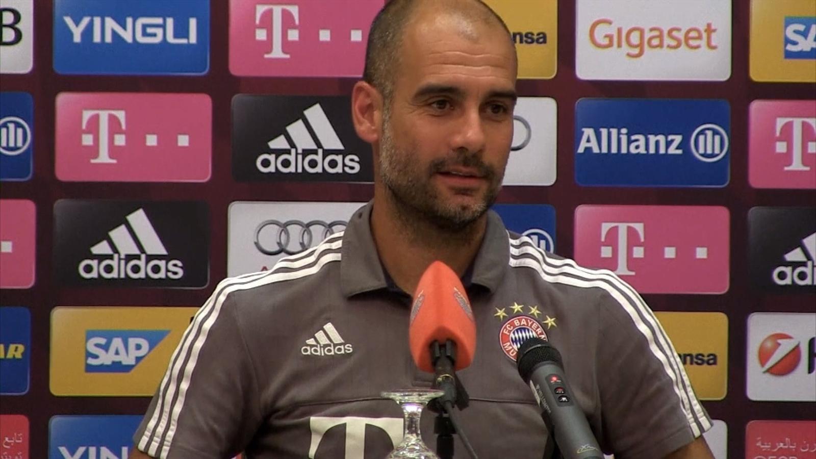 Bayern Munich boss Pep Guardiola at a press conference in Doha