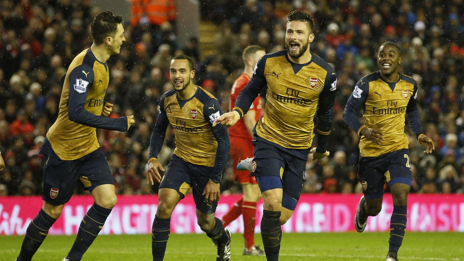 Olivier Giroud celebrates scoring the third goal for Arsenal against Liverpool