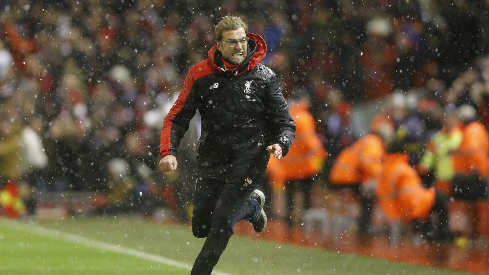 Liverpool manager Jurgen Klopp celebrates after Joe Allen scores against Arsenal