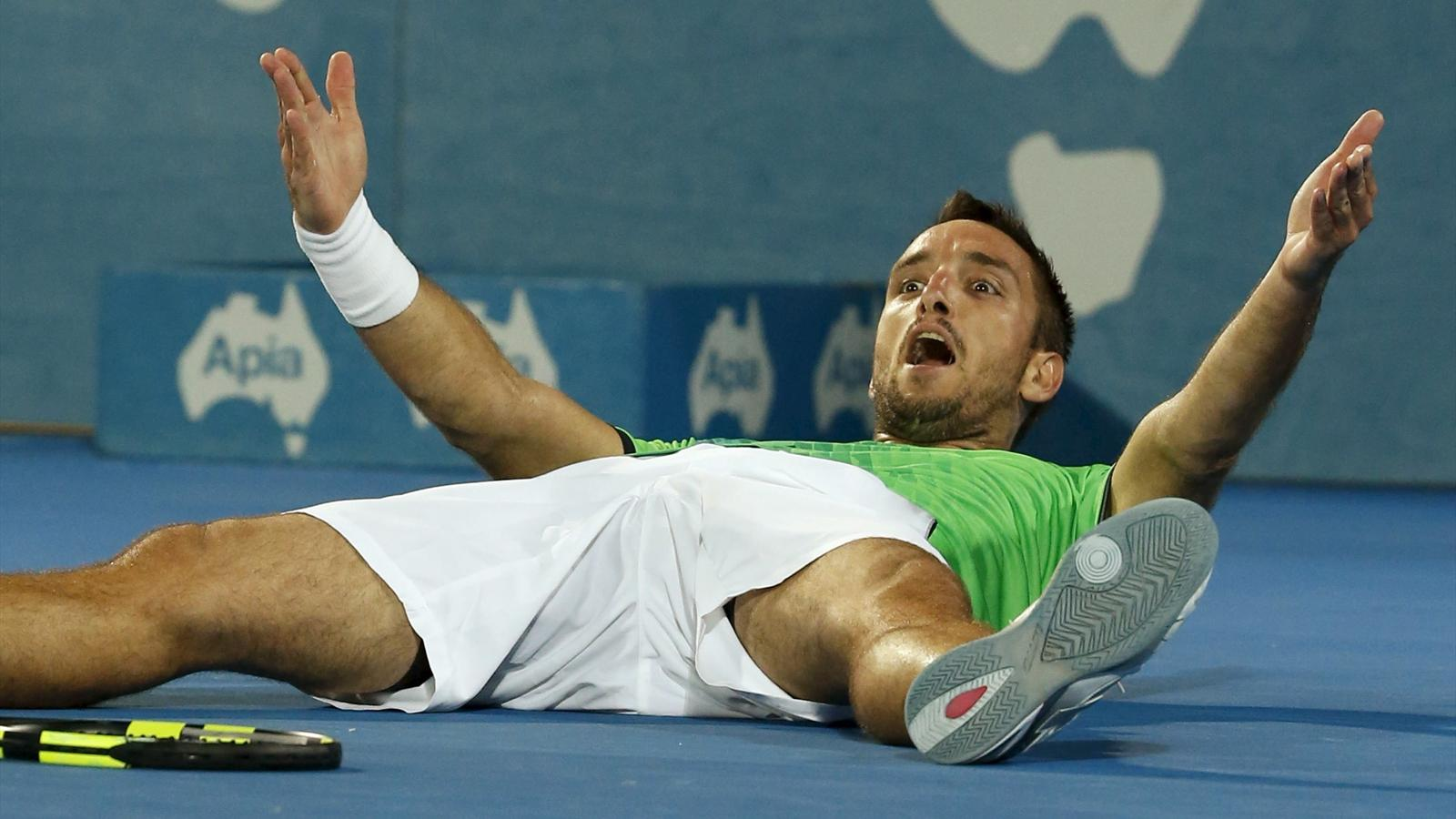 Viktor Troicki of Serbia reacts after defeating Grigor Dimitrov of Bulgaria to win their men's singles final at the Sydney International