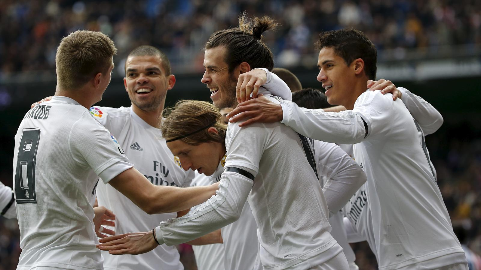 Real Madrid's Gareth Bale celebrates his first goal against Sporting Gijon with teammates