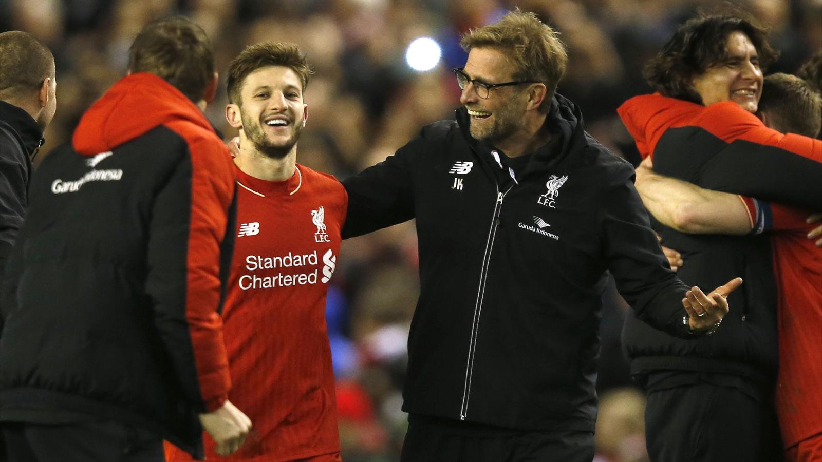 Liverpool manager Juergen Klopp celebrates with Adam Lallana after winning the penalty shootou