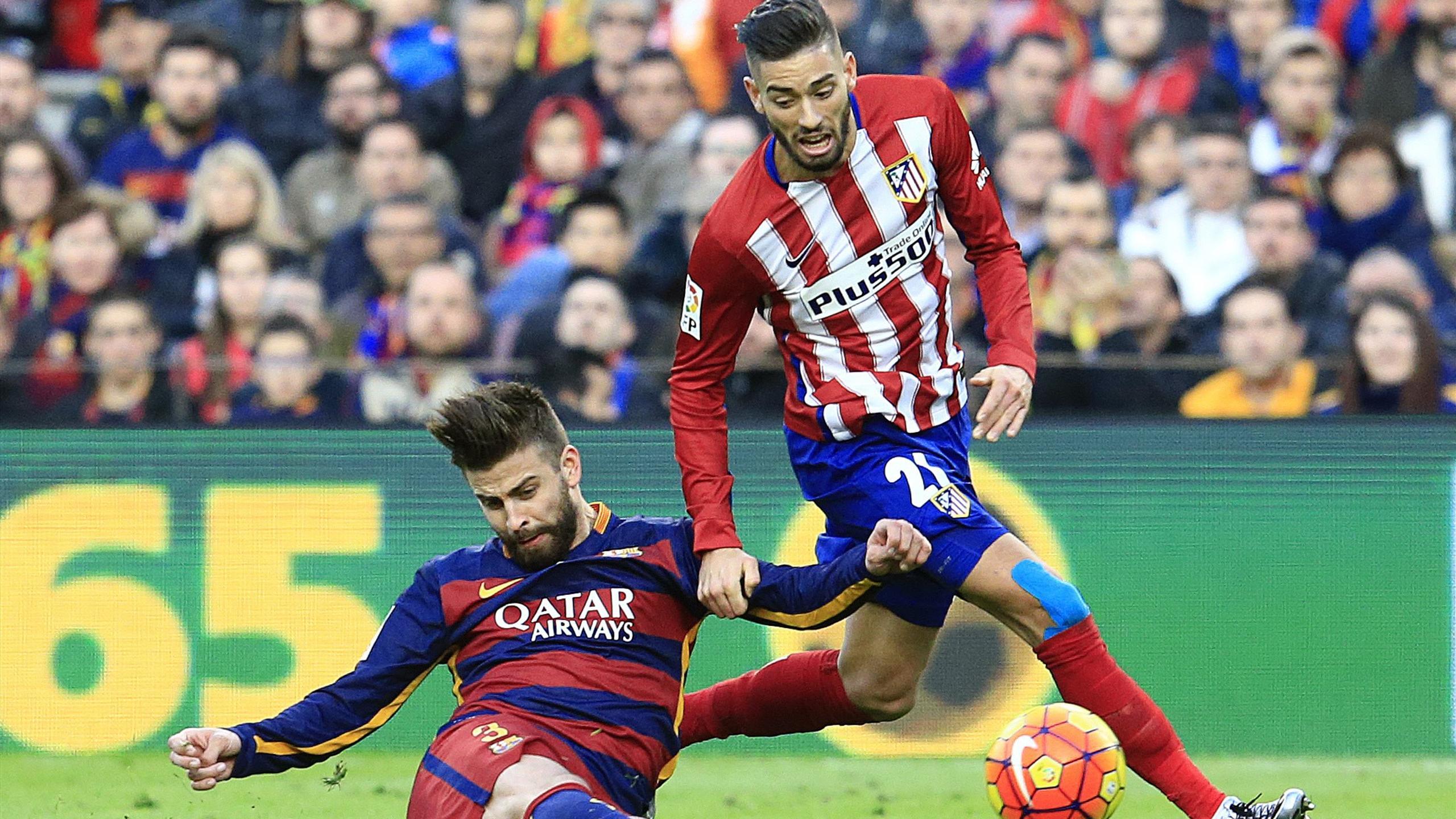 Gerard Piqué y Carrasco en el FC Barcelona-Atlético de Madrid