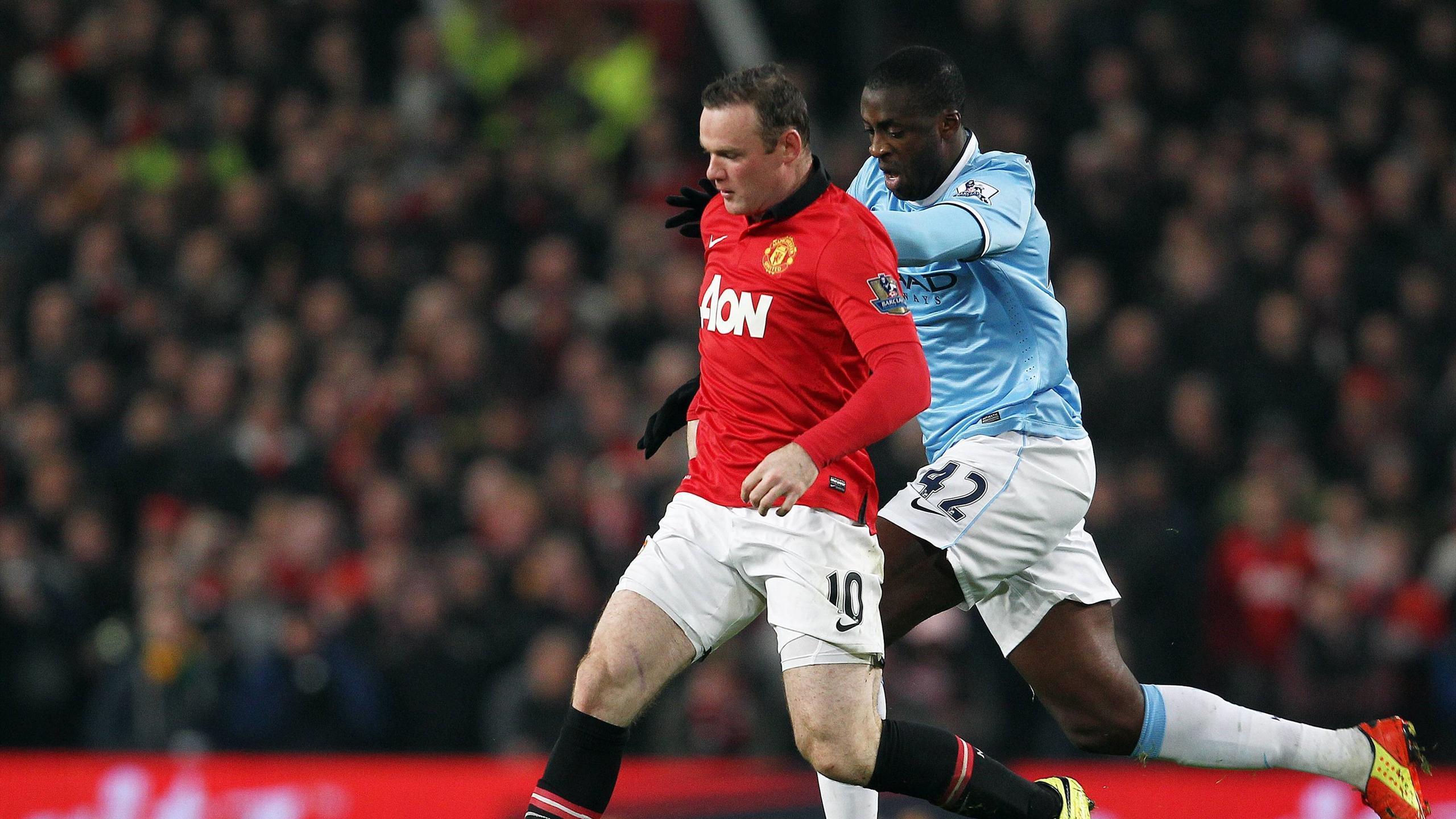 Уэйн Руни и Яя Туре в матче «Манчестер Юнайтед» – «Манчестер Сити»