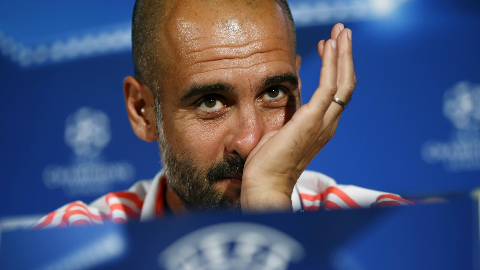 Bayern Munich's coach Pep Guardiola listens to a question during a news conference at the team's hotel ahead of their Champions League group F soccer match against Olympiacos in Athens