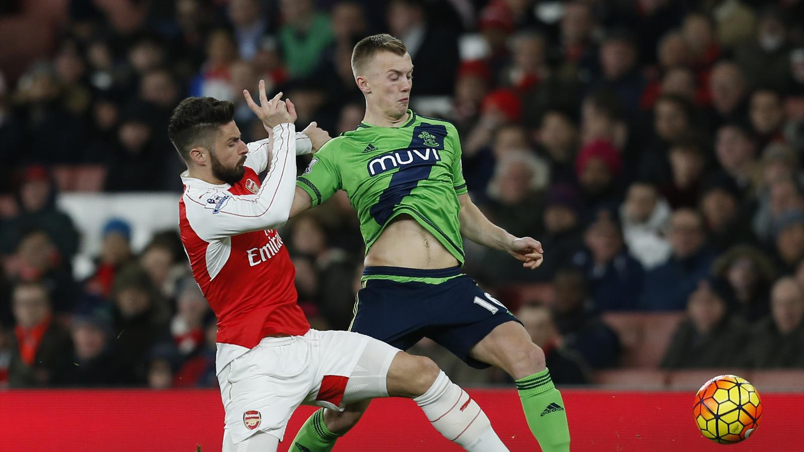 Arsenal's French striker Olivier Giroud (L) vies with Southampton's English midfielder James Ward-Prowse (R) during the English Premier League football match between Arsenal and Southampton at the Emirates Stadium in London on February 2, 2016