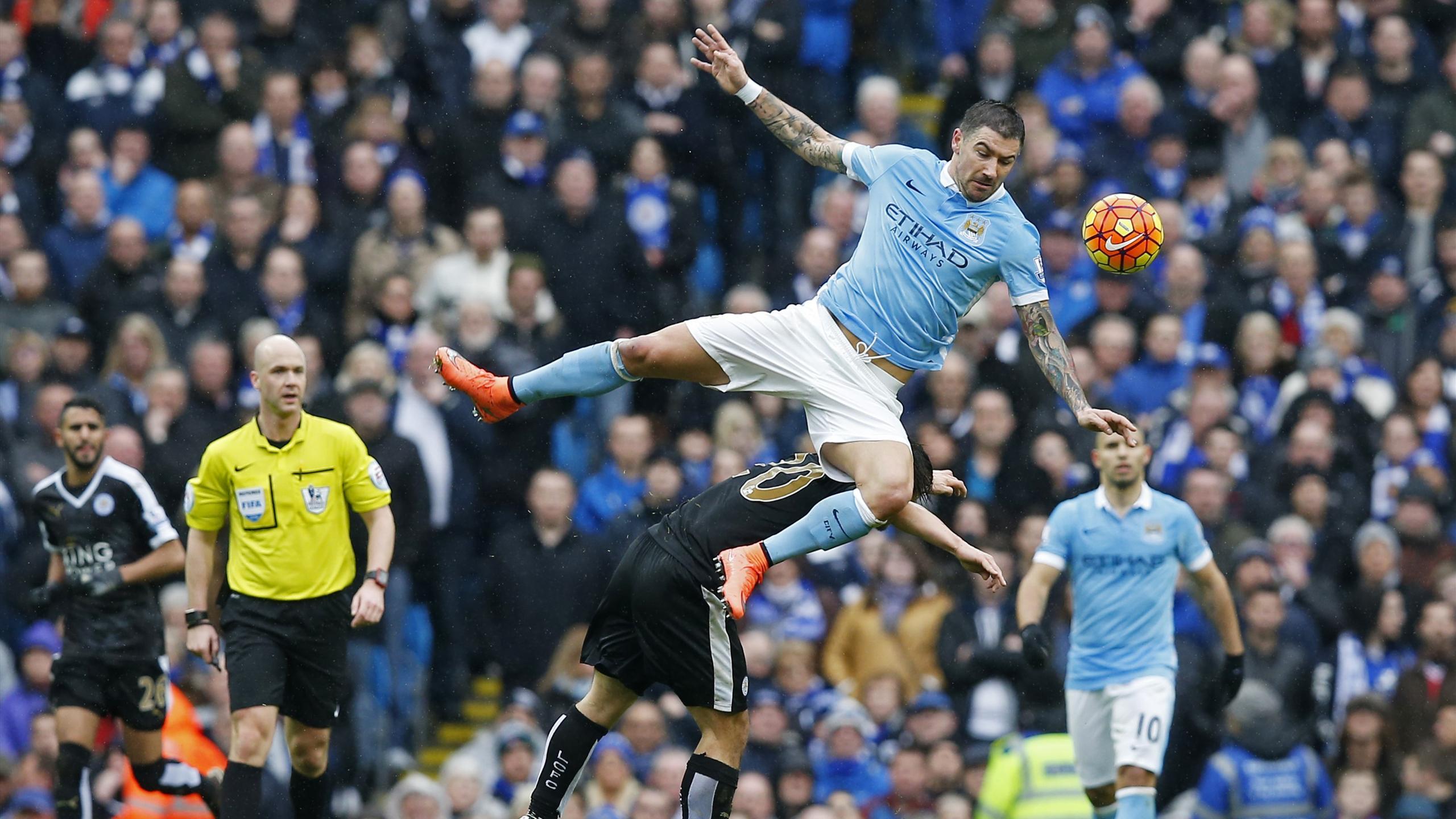 Aleksandar Kolarov takes a tumble against Leicester City