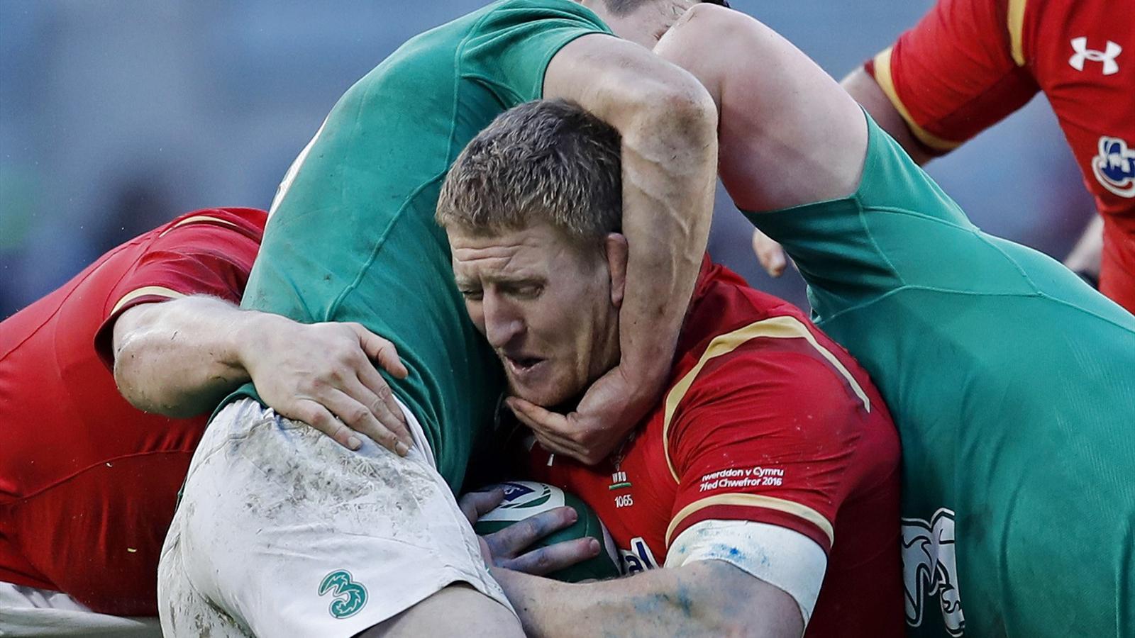 Ireland's Jonathan Sexton tackles Wales' Bradley Davies