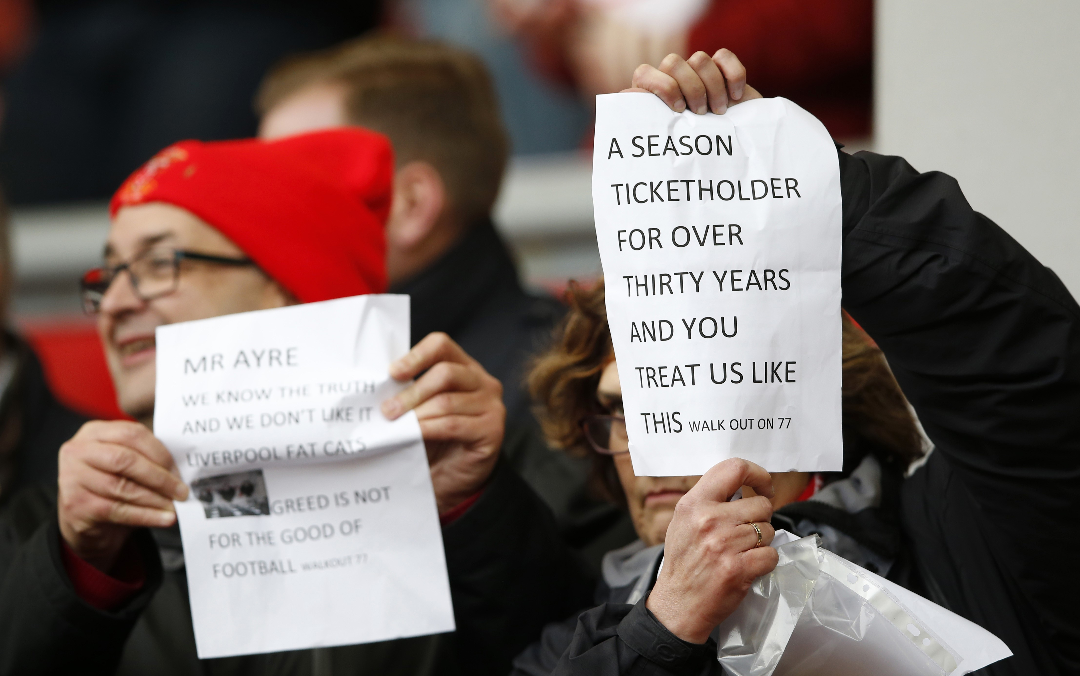 Liverpool fans make their feelings known at Anfield.