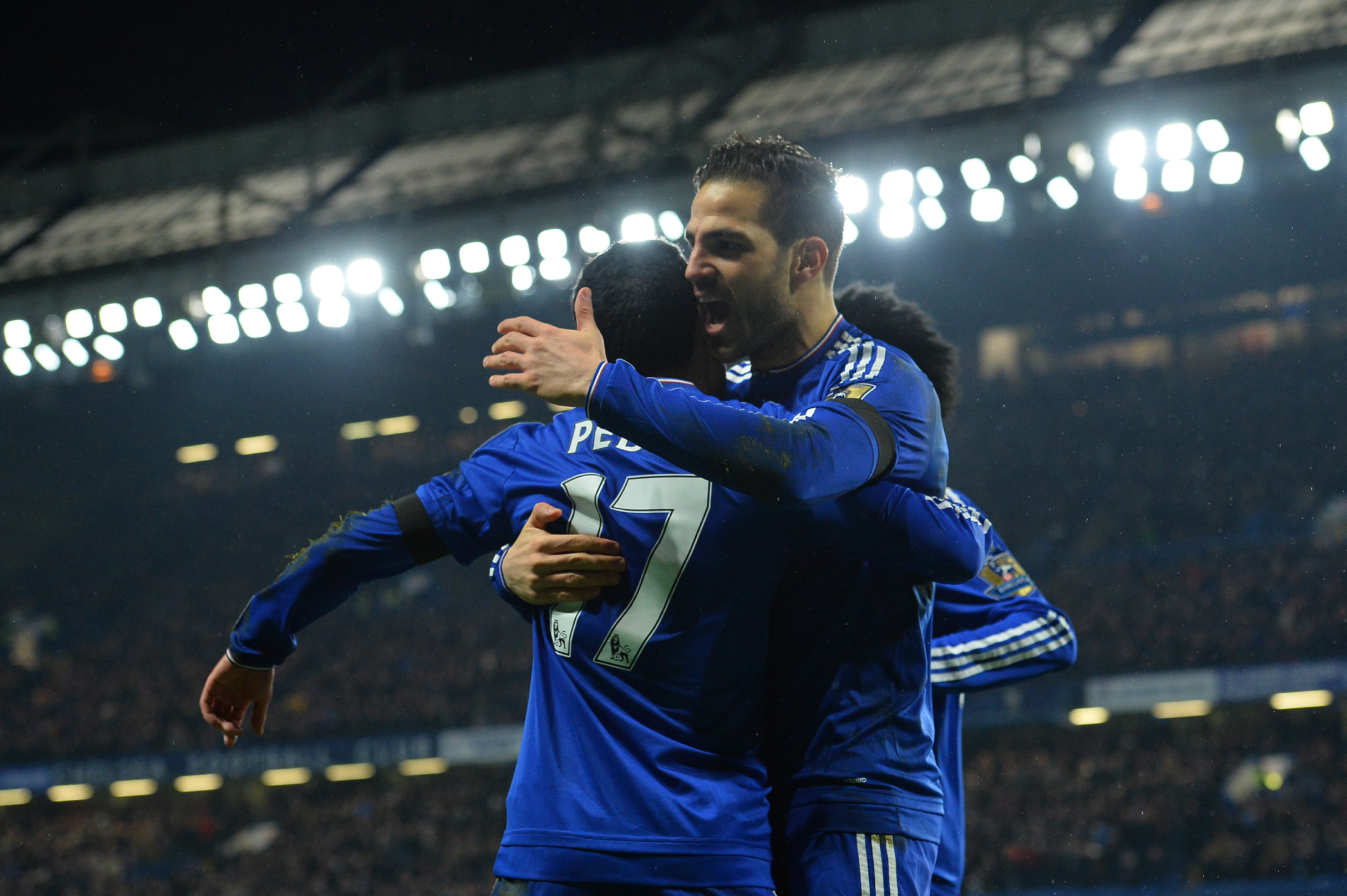 Chelsea's Spanish midfielder Pedro (L) celebrates scoring his team's second goal with Chelsea's Spanish midfielder Cesc Fabregas during the English Premier League football match between Chelsea and Newcastle United at Stamford Bridge in London on February
