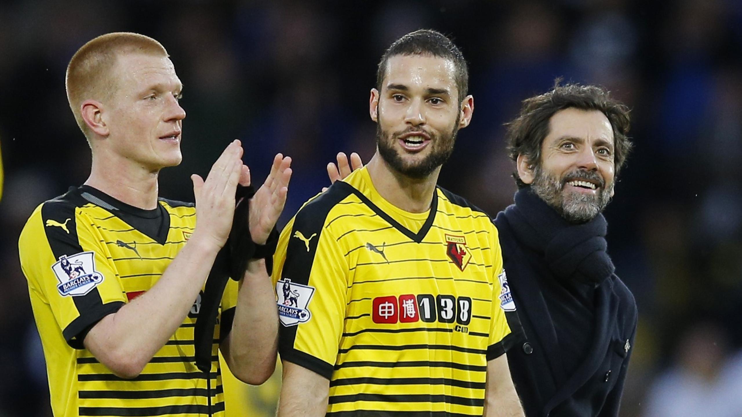 Watford's Ben Watson, Mario Suarez and manager Quique Sanchez Flores celebrate after the game