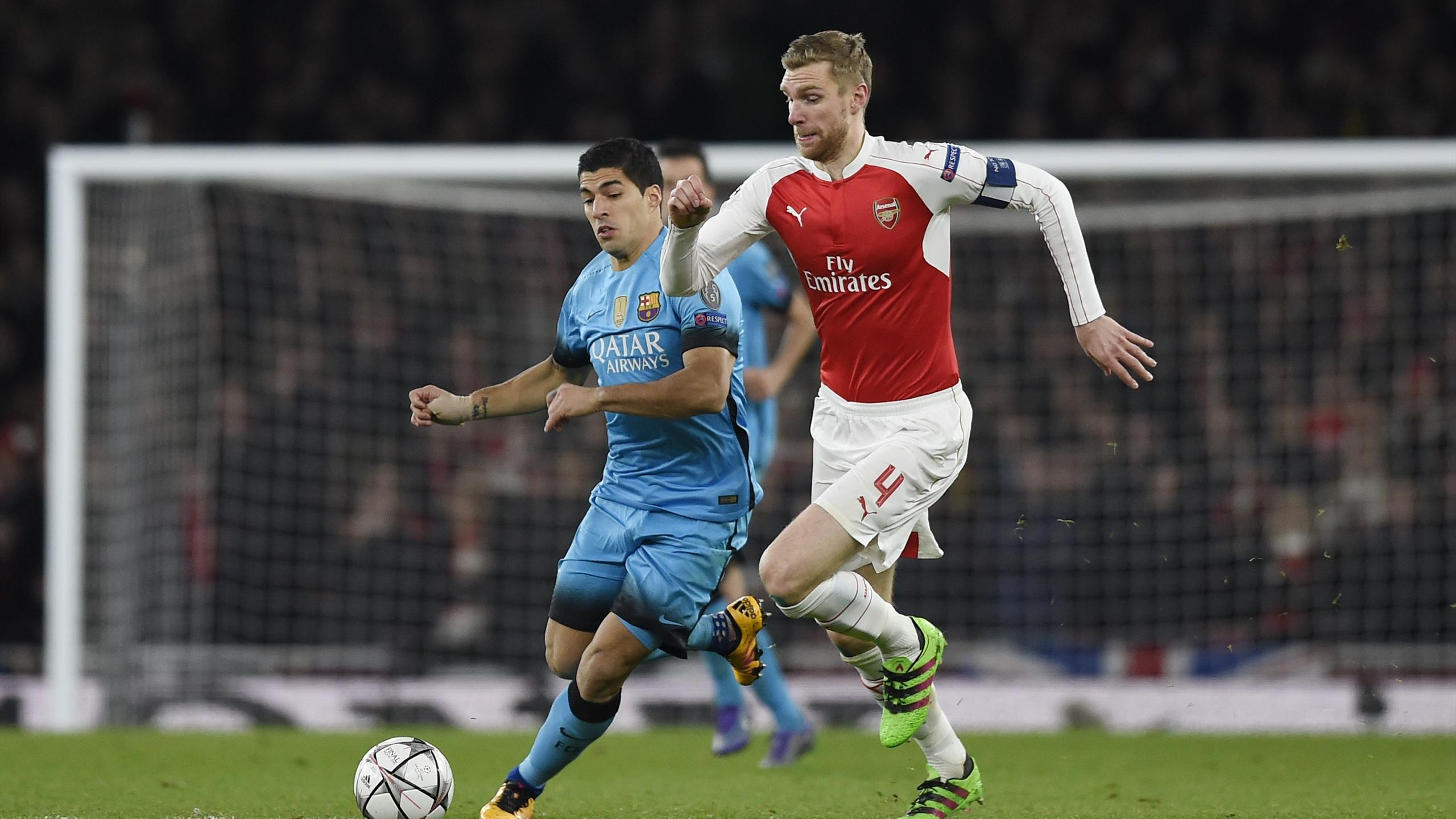 Barcelona's Luis Suarez in action with Arsenal's Per Mertesacker