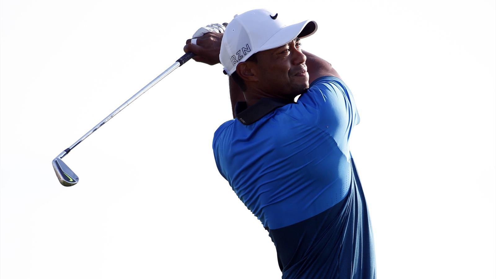 Tiger Woods looks \