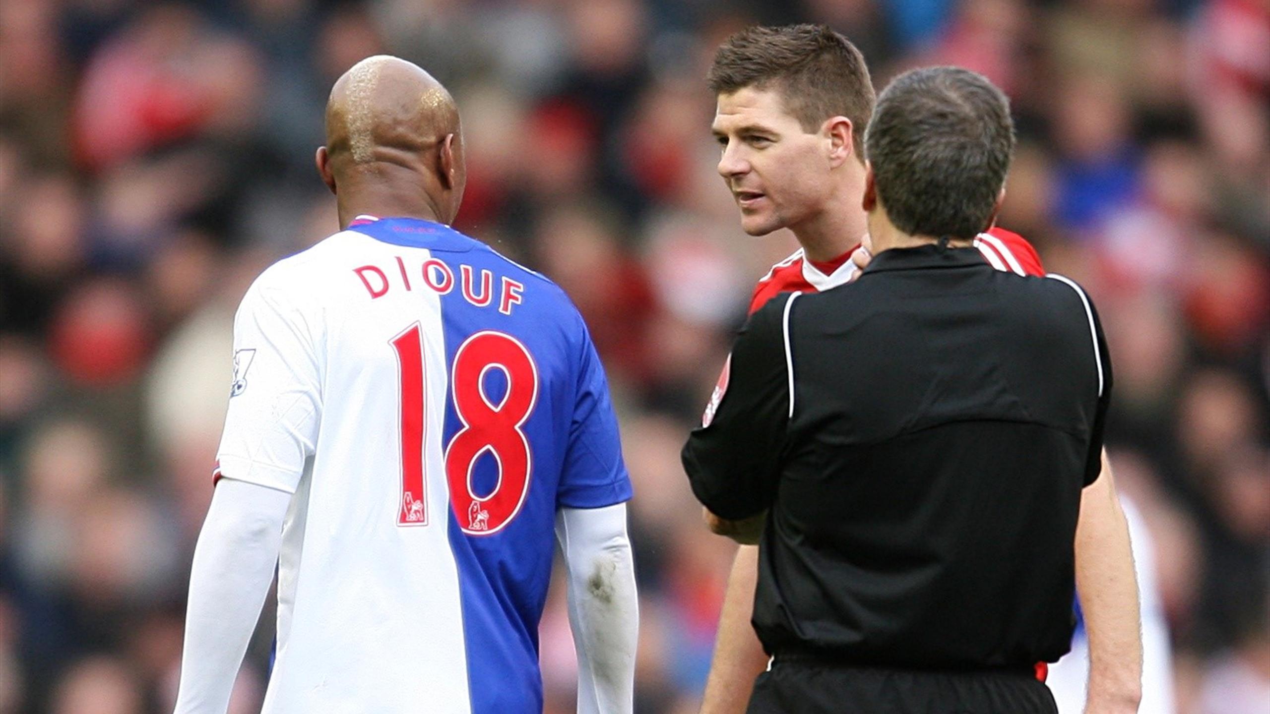 Blackburn Rovers' El-Hadji Diouf (left) argues with Liverpool's Steven Gerrard (right).