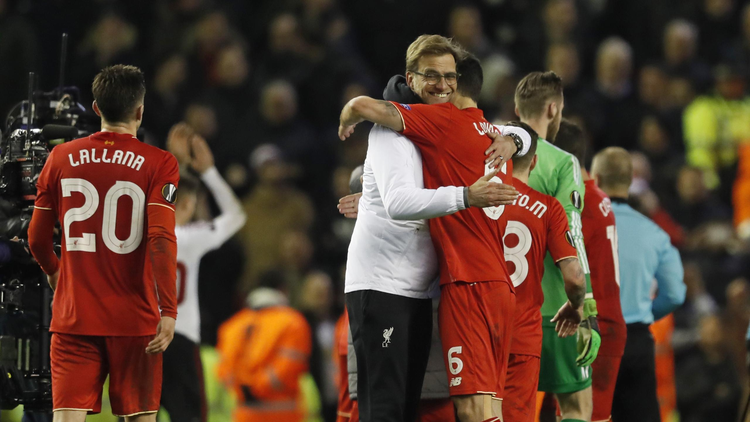 Liverpool manager Juergen Klopp celebrates with Dejan Lovren at the end of the match