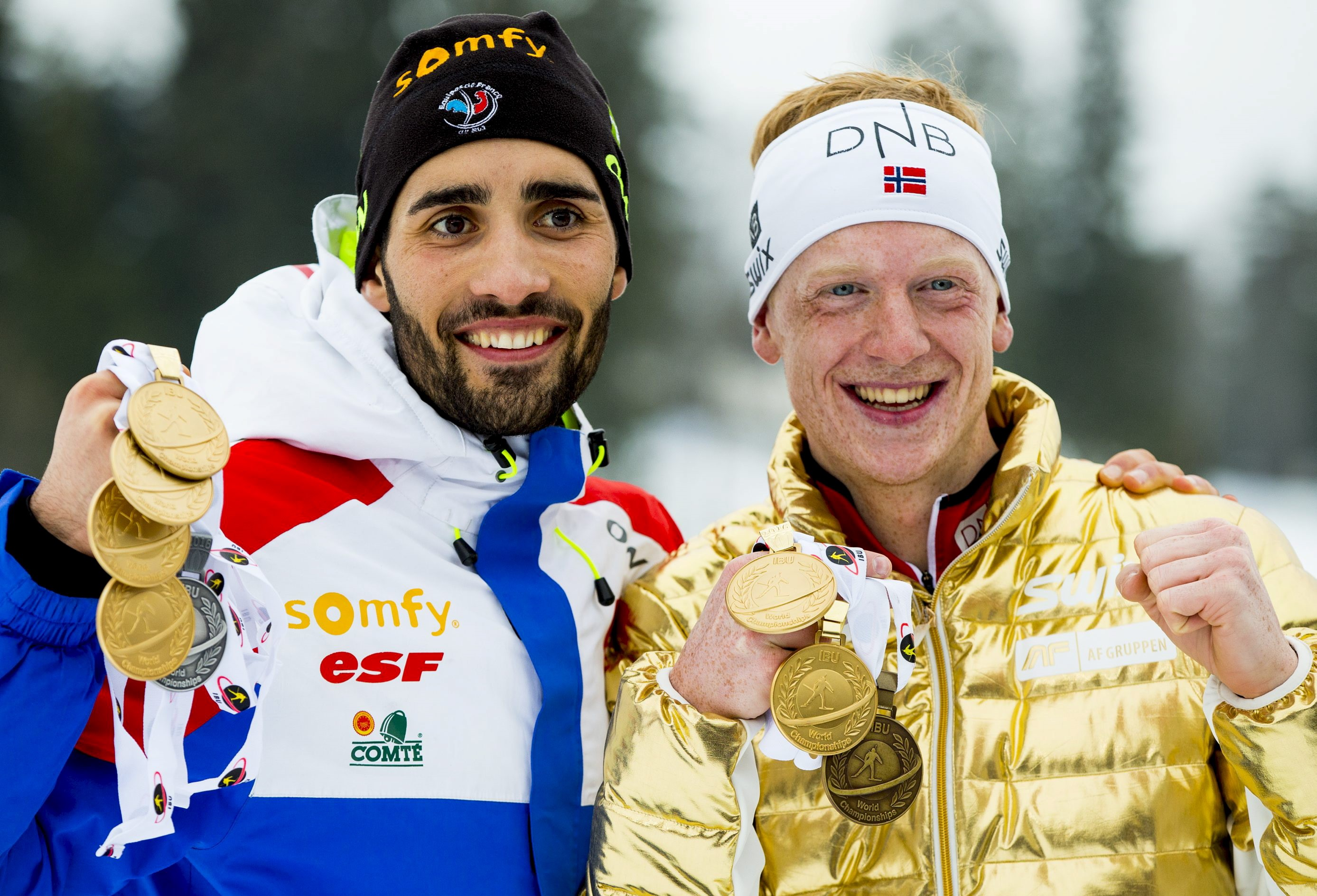 Martin Fourcade (L) of France and Johannes Thingnes Boe of Norway display their medals after the IBU World Championships Biathlon