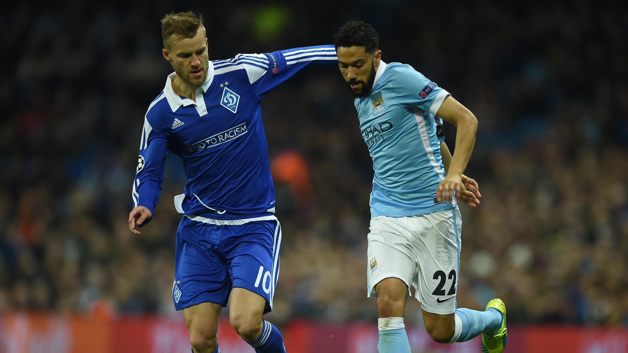 Dynamo Kiev's Ukrainian midfielder Andriy Yarmolenko (L) vies with Manchester City's French defender Gael Clichy
