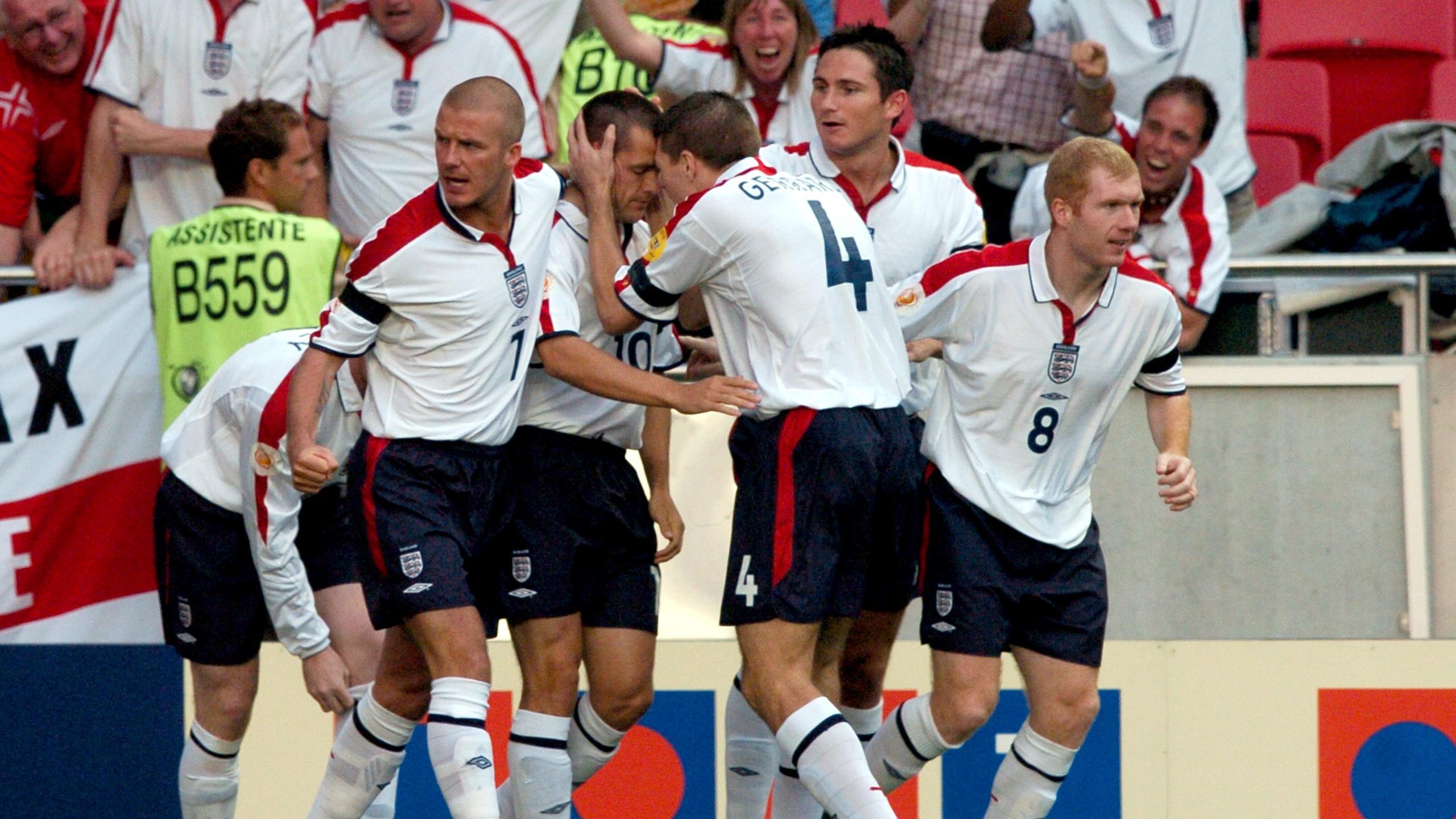 England's David Beckham, Frank Lampard, Wayne Rooney, Paul Scholes and Steven Gerrard congratulate Michael Owen on his opening goal