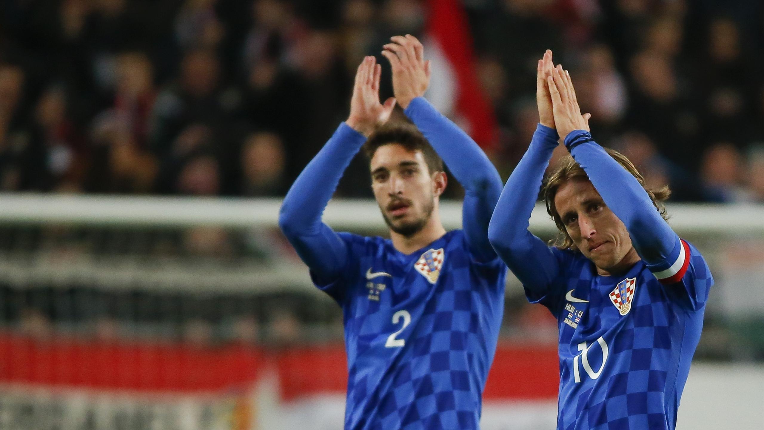 Croatia's Sime Vrsaljko and Luka Modric react after the friendly with Hungary