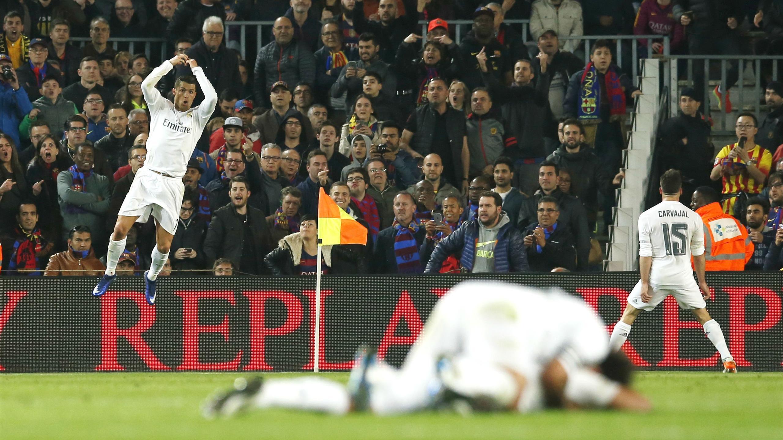 Real Madrid celebrate Cristiano Ronaldo's late winner against Barcelona