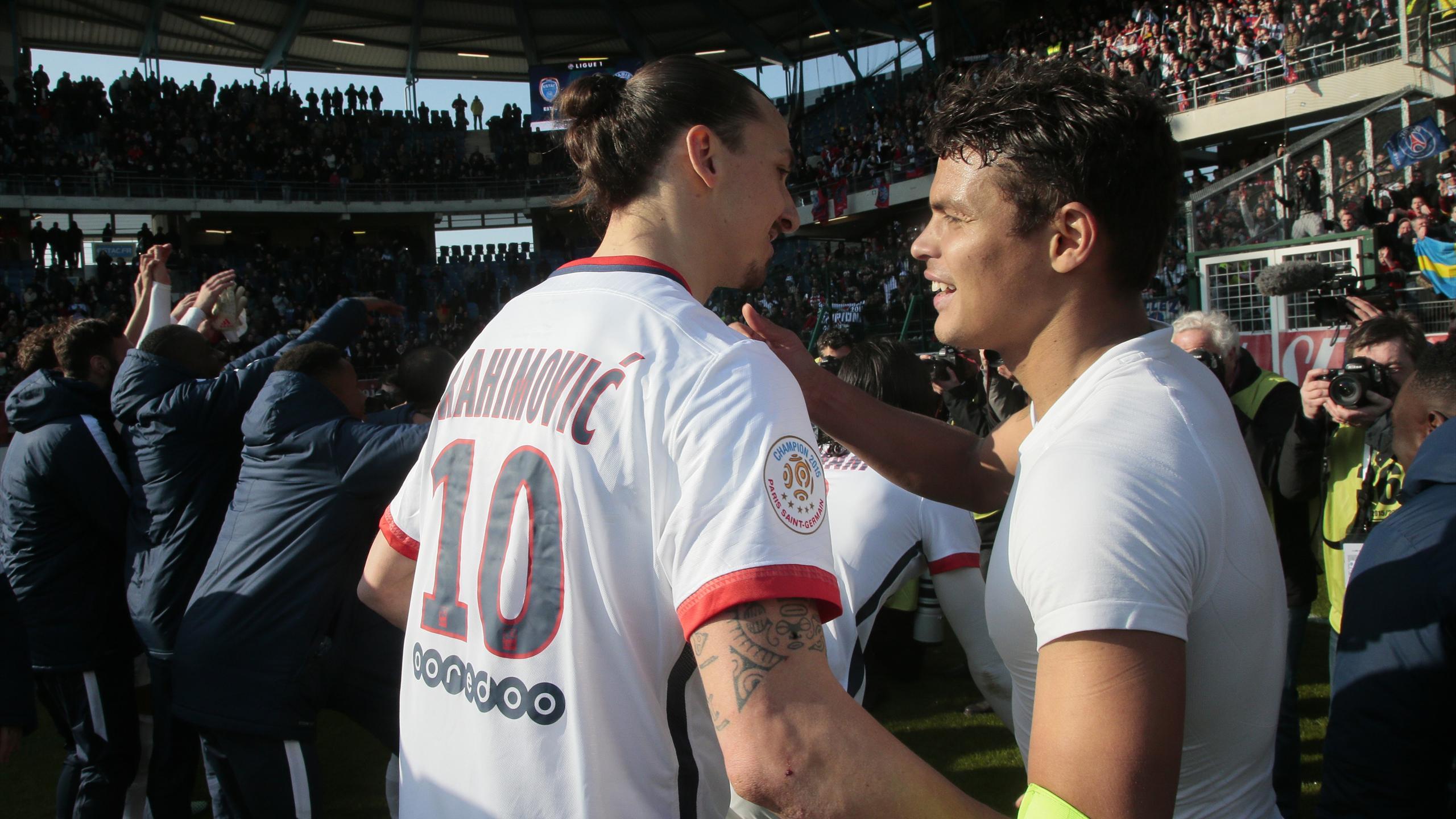 Paris Saint-Germain's Brazilian defender Thiago Silva (R) celebrates with Swedish forward Zlatan Ibrahimovic