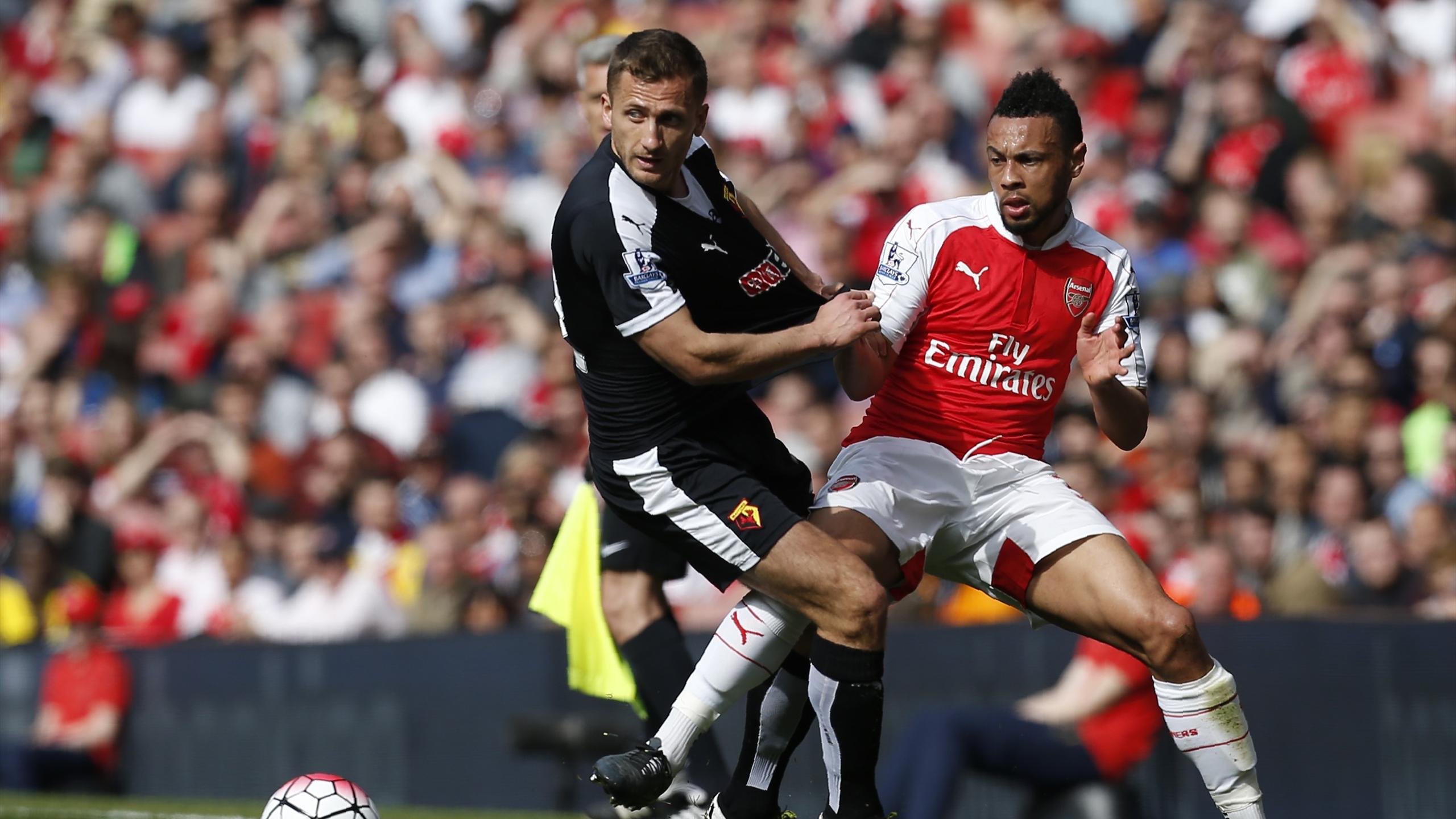 Watford's Yugoslavian-born Swiss midfielder Almen Abdi (L) vies with Arsenal's French midfielder Francis Coquelin
