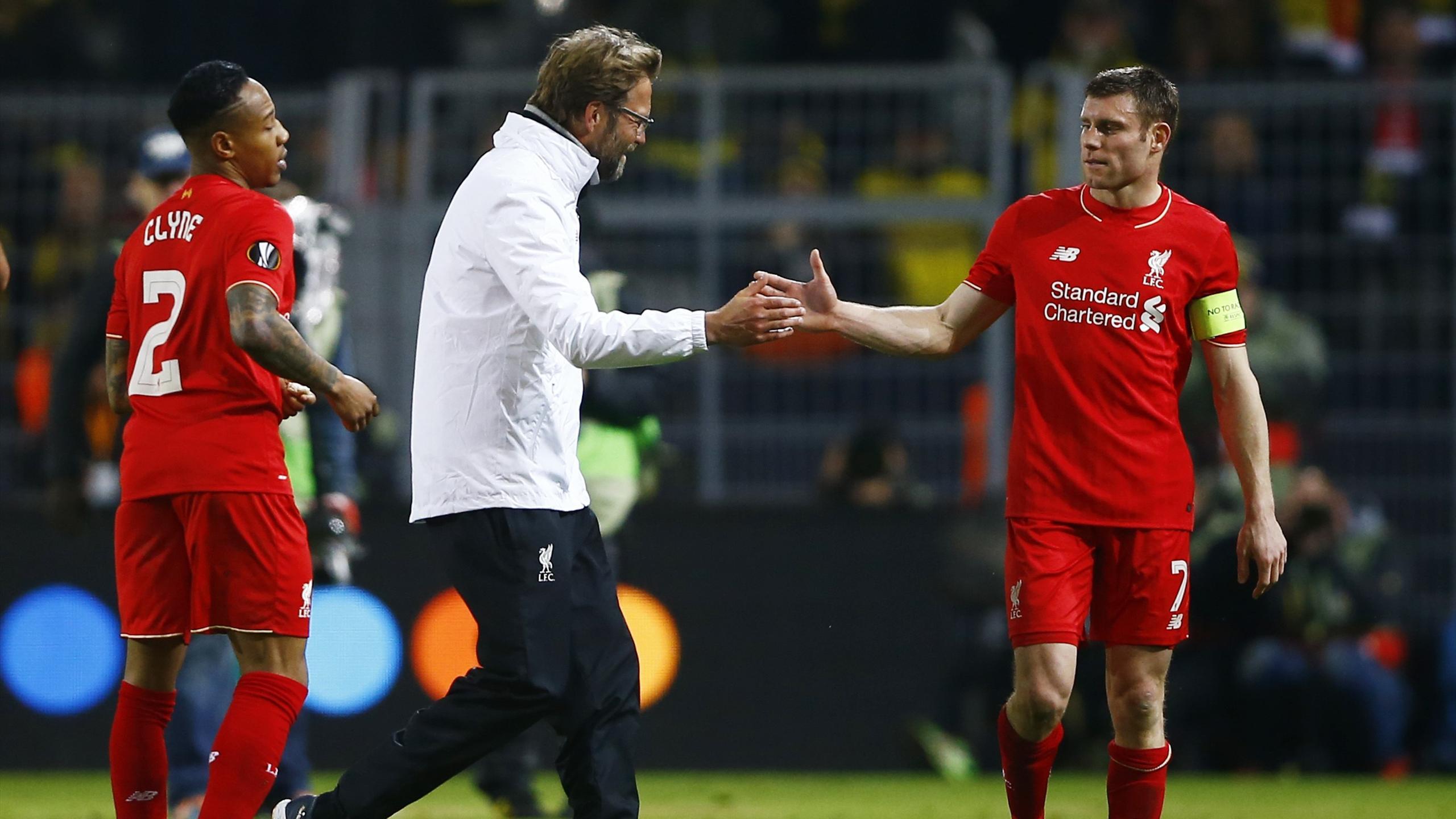 Liverpool manager Jurgen Klopp celebrates with James Milner after the game