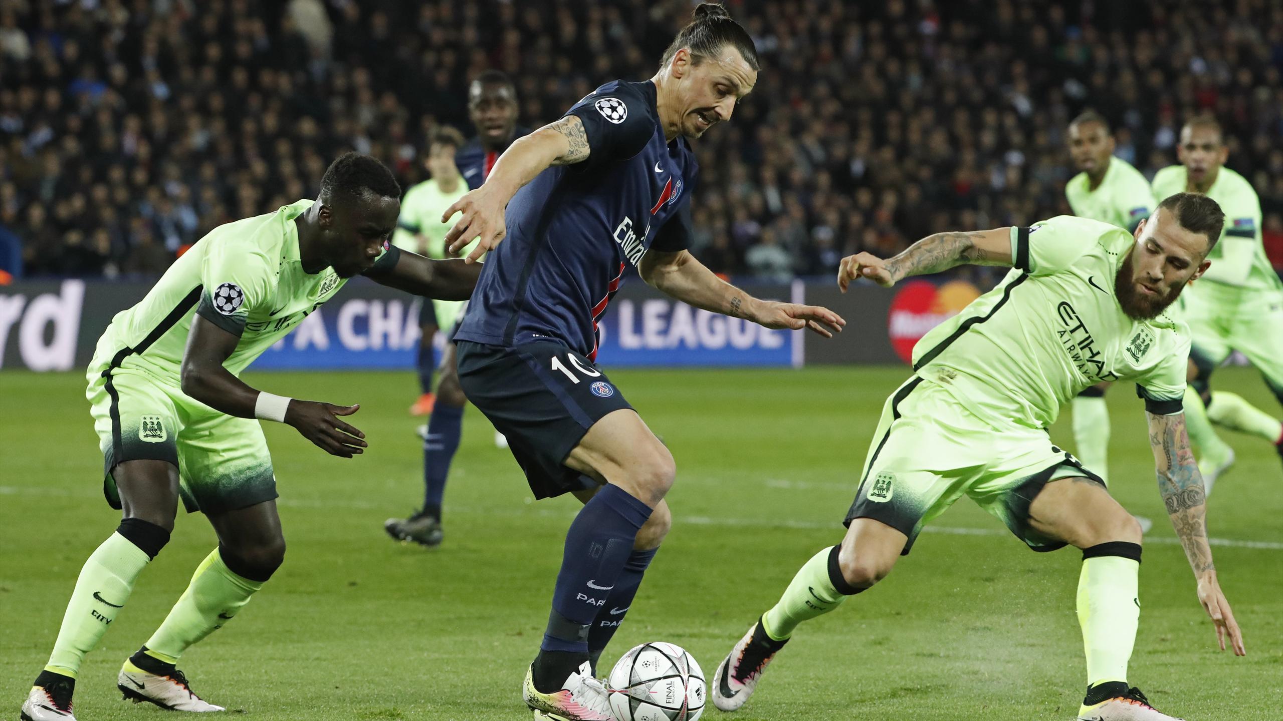 Manchester City's Nicolas Otamendi in action with PSG's Zlatan Ibrahimovic