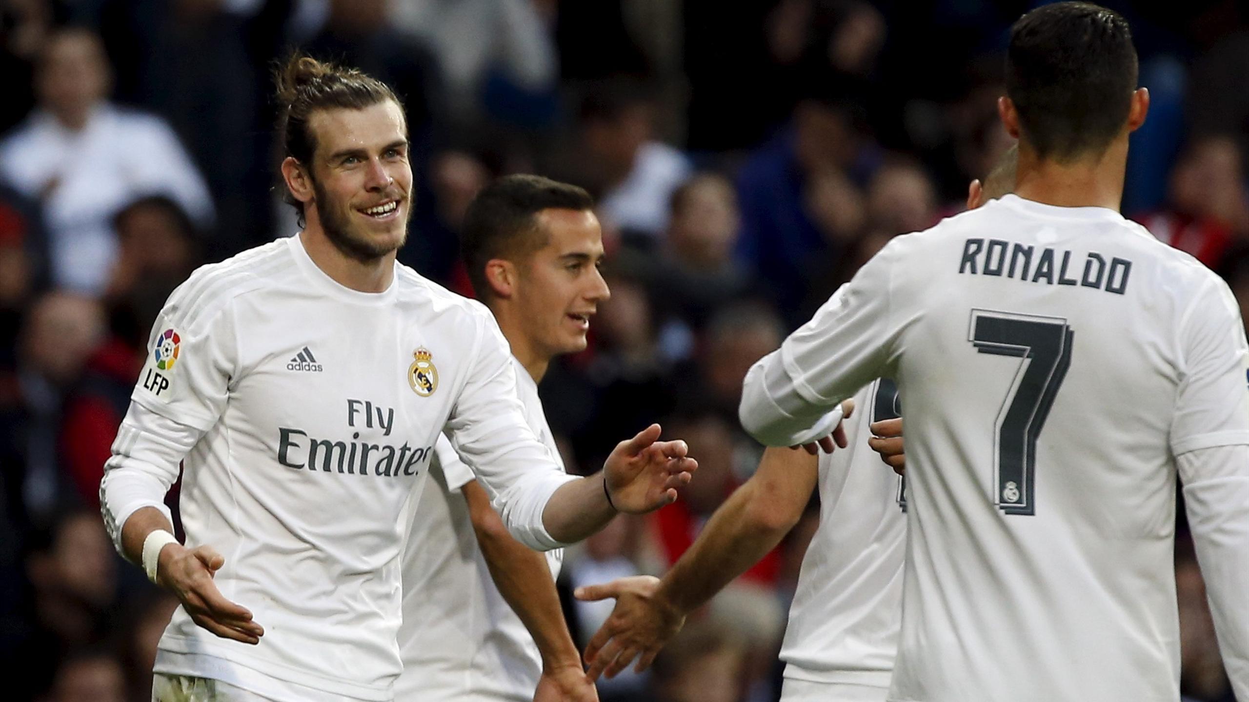 Real Madrid's Gareth Bale celebrates his fourth goal with team-mate Cristiano Ronaldo