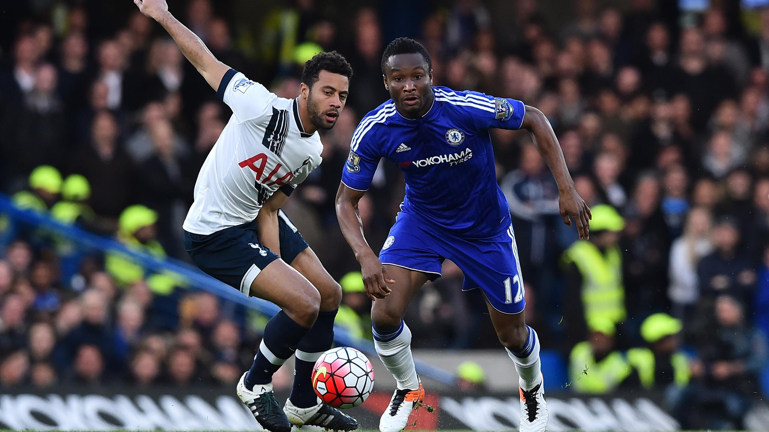 Tottenham Hotspur's Belgian midfielder Mousa Dembele (L) vies with Chelsea's Nigerian midfielder John Obi Mikel