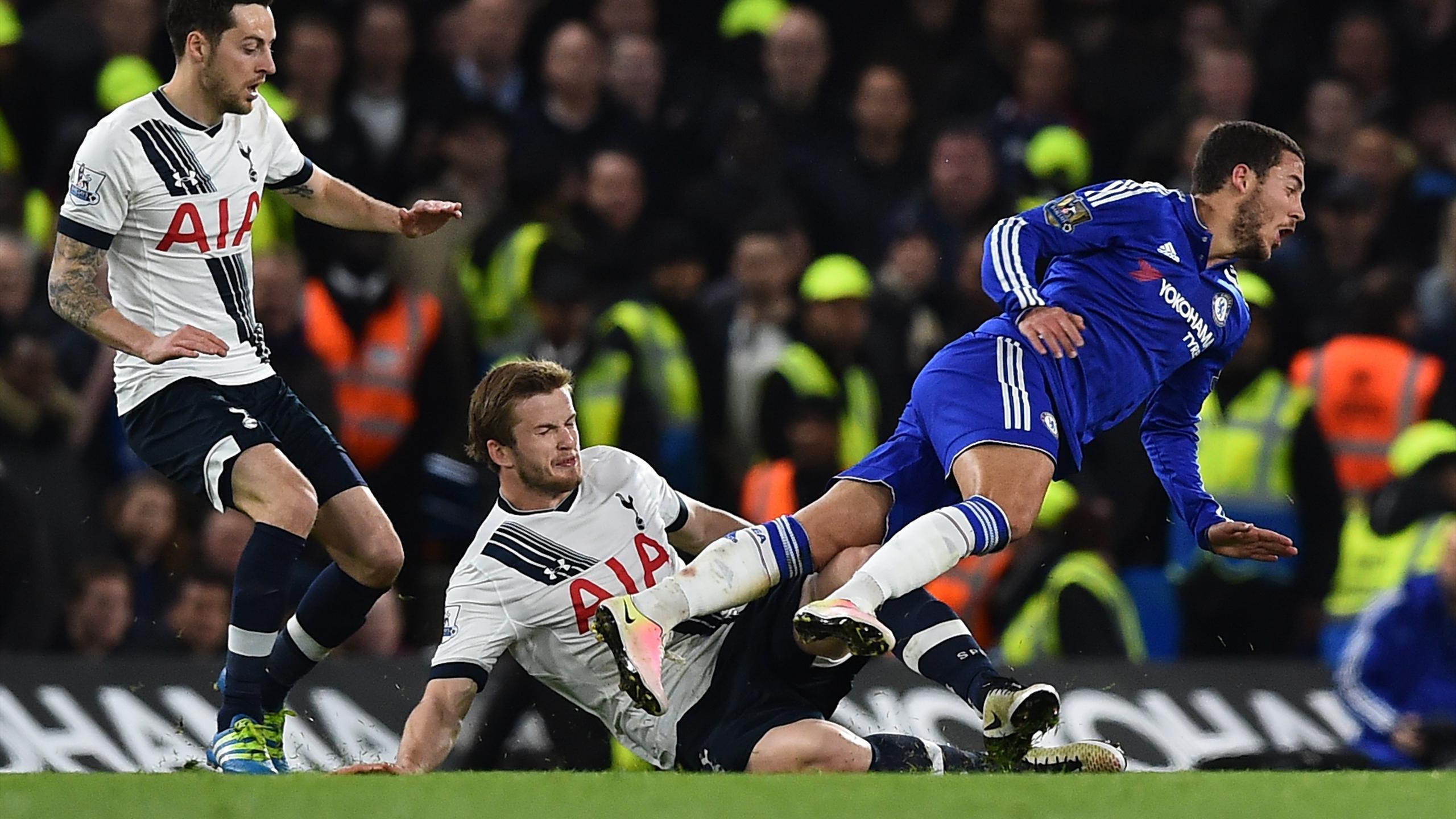 Tottenham Hotspur's English defender Eric Dier (C) fouls Chelsea's Belgian midfielder Eden Hazard (R)