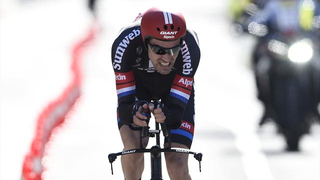 Dumoulin wins opening time trial to take pink