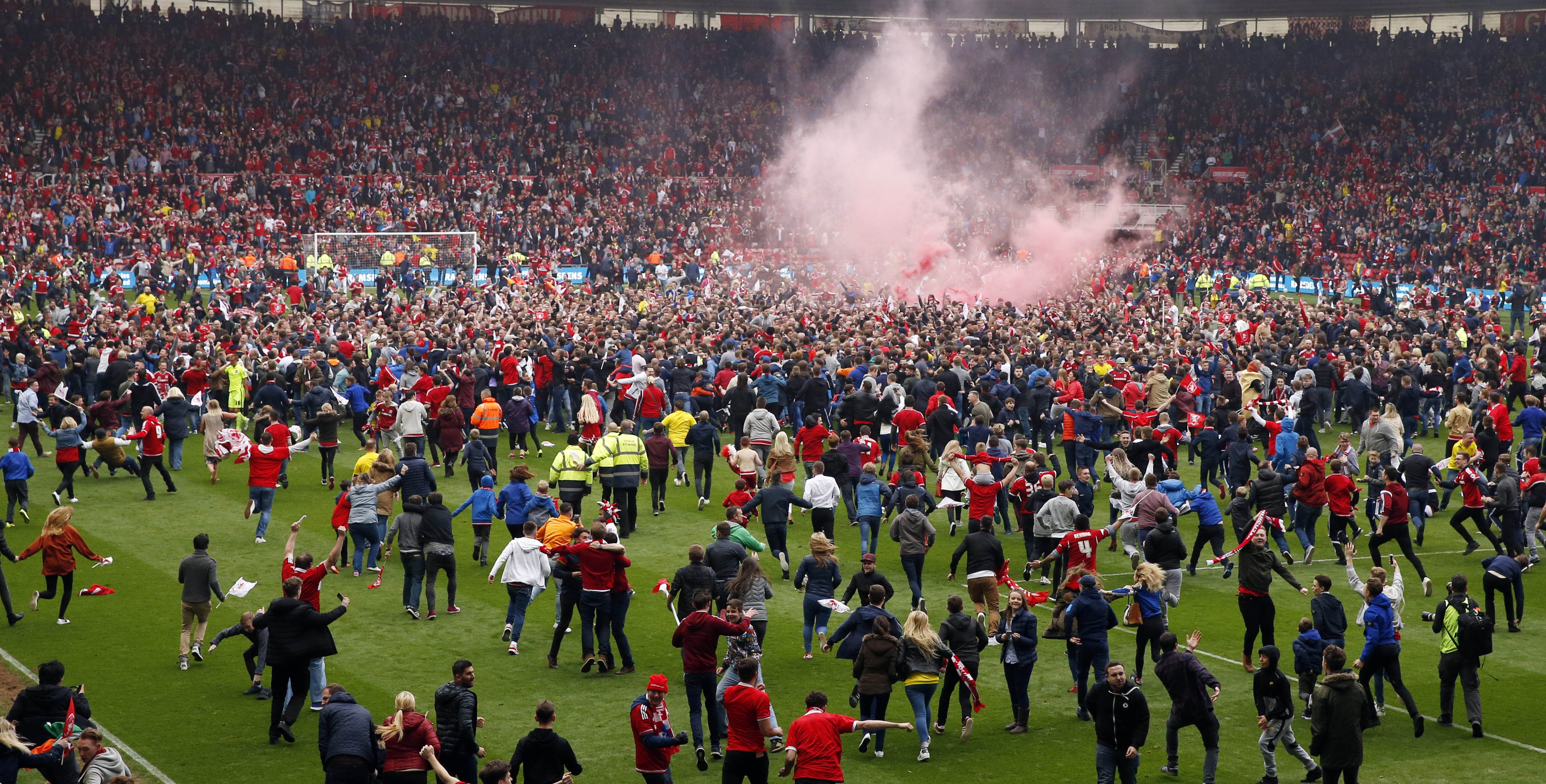 Middlesbrough fans invade pitch after securing promotion - they're back in top flight for first time since 2009