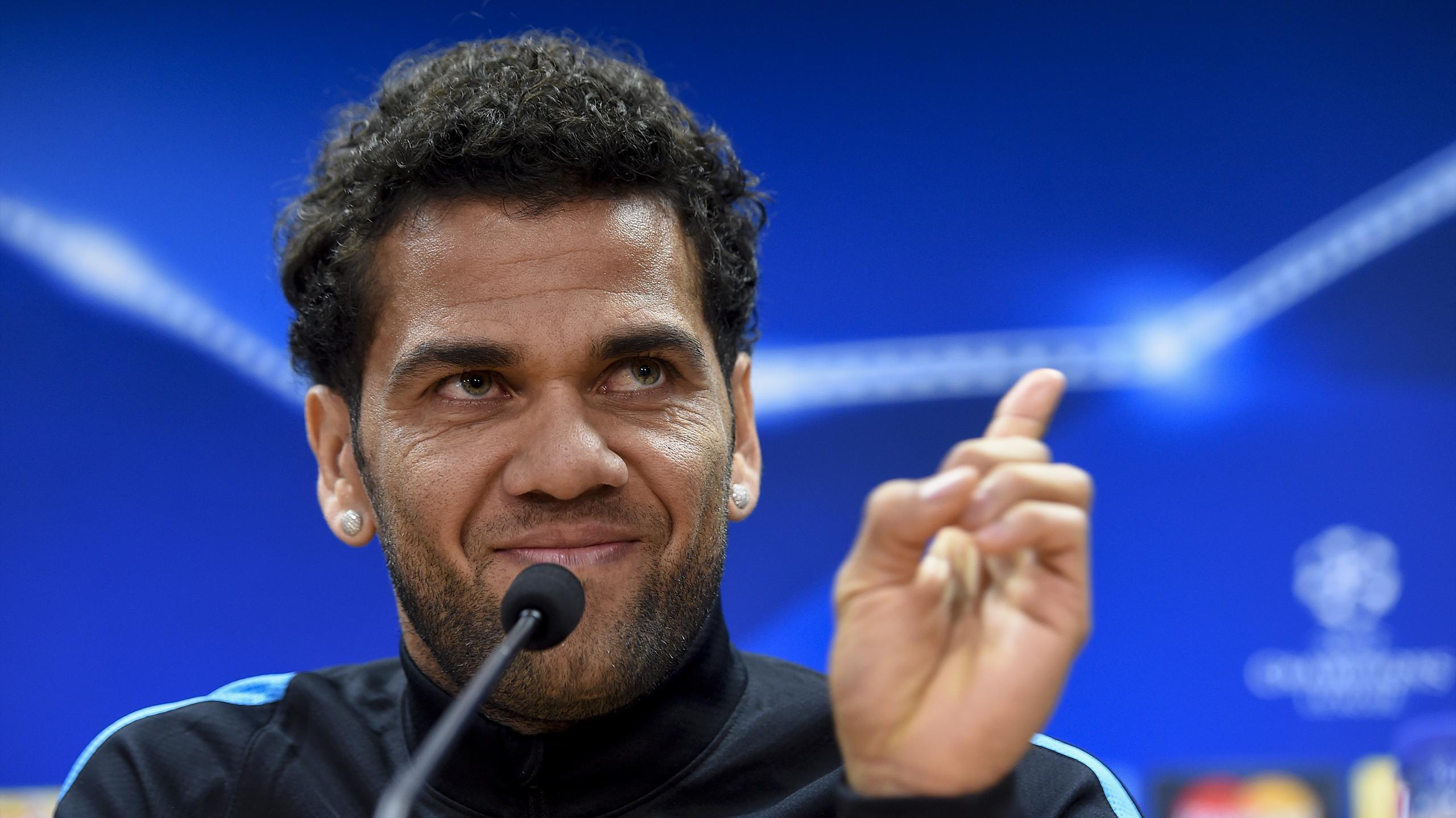 Barcelona's Brazilian defender Dani Alves gestures as he answers journalists