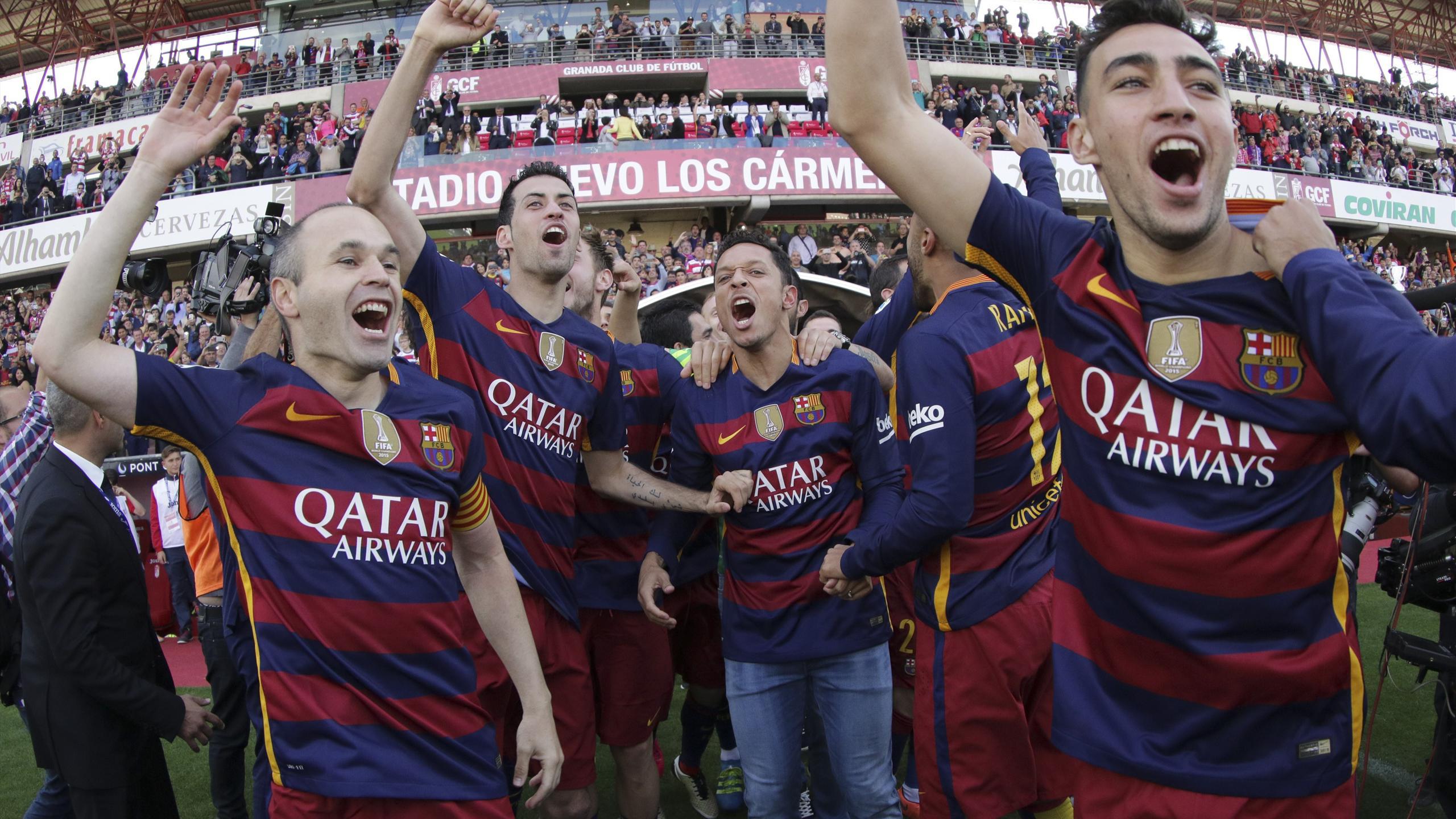 Barcelona's Andres Iniesta, Sergio Busquets, Adriano and Munir el Haddadi celebrate after winning La Liga