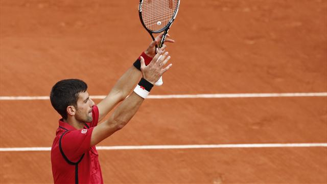 Djokovic eases into second round with straight-sets win