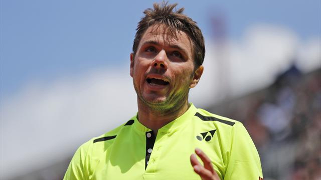 Wawrinka finds champion touch to reach third round