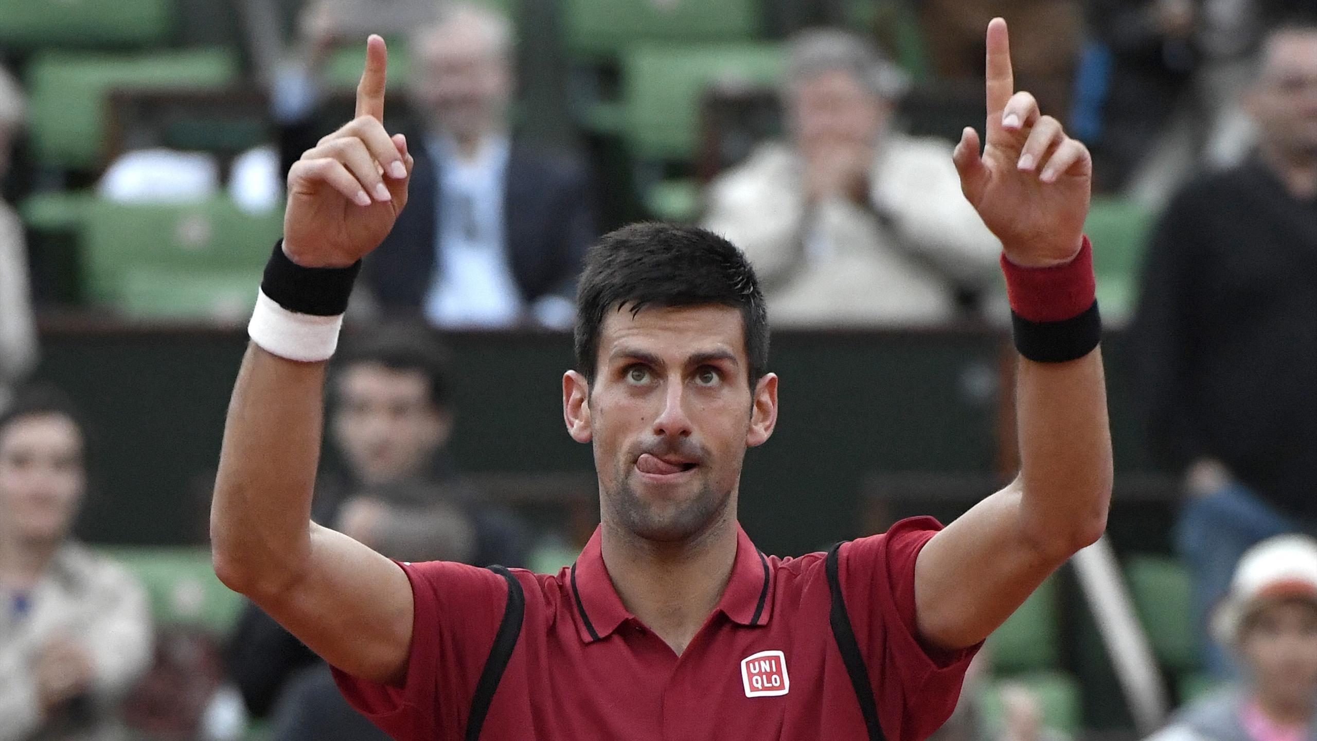 Novak Djokovic celebrates winning at Roland Garros