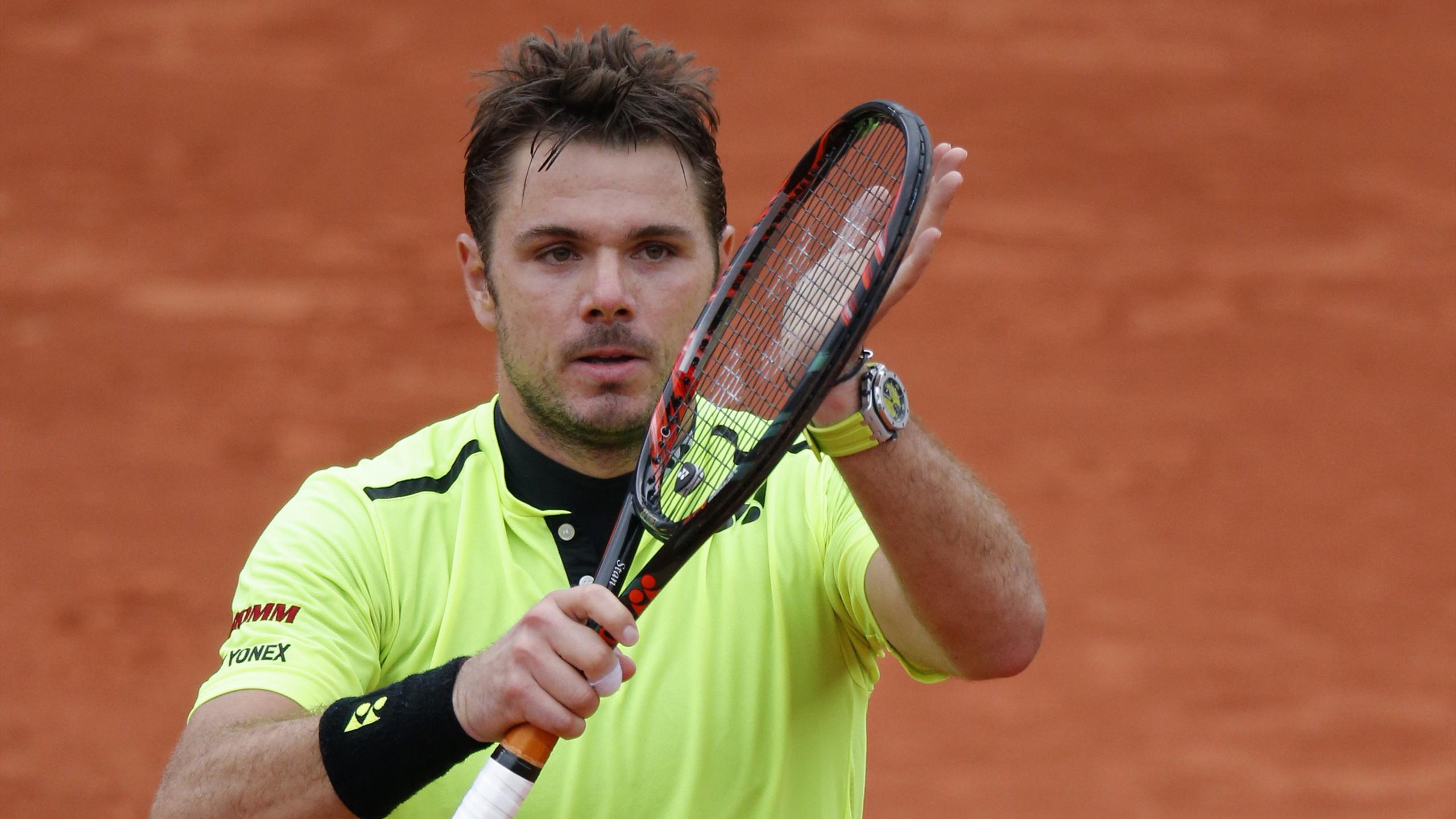 Stanislas Wawrinka celebrates beating Viktor Troicki at the French Open