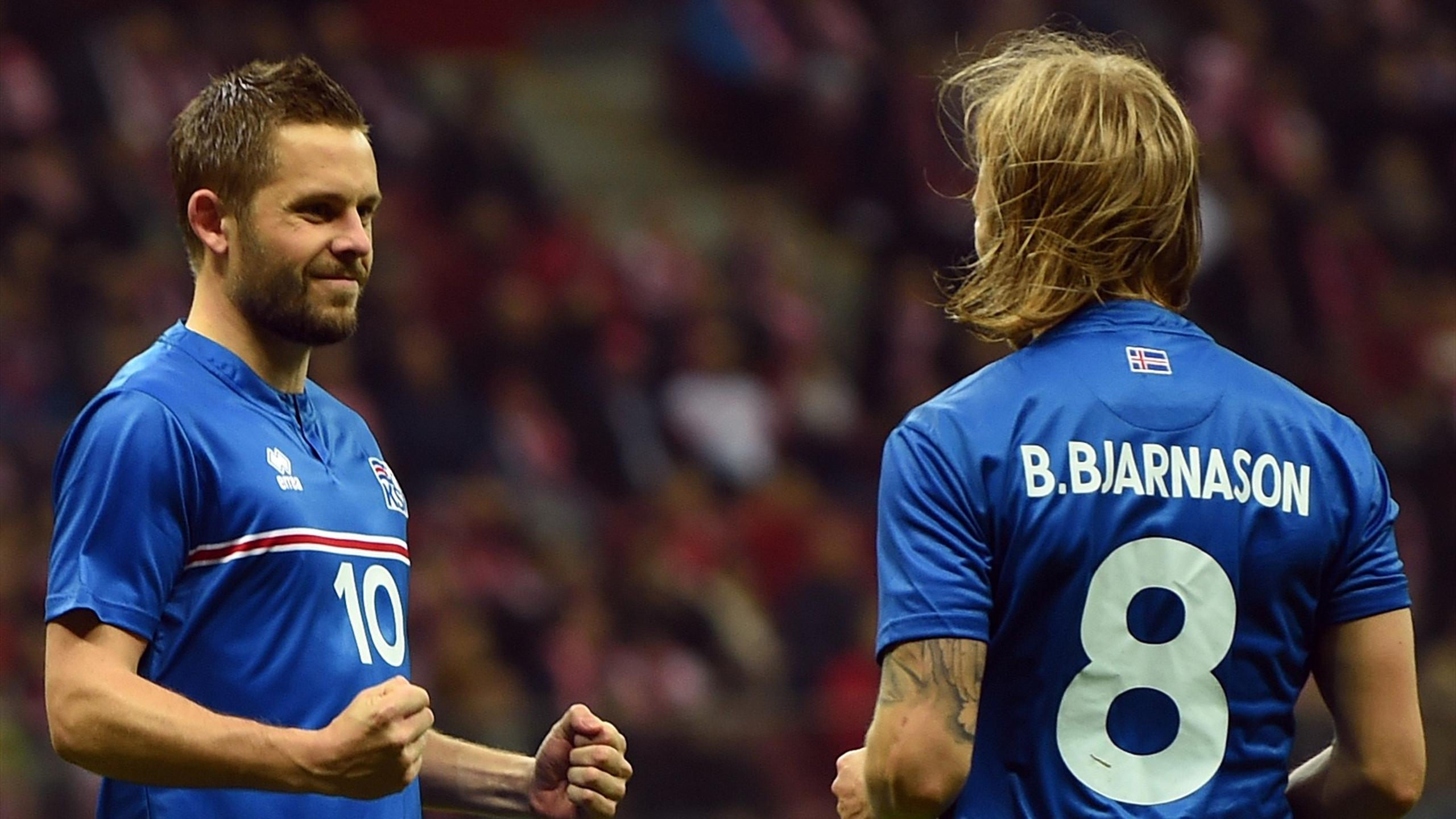 Iceland's Gylfi Sigurdsson and Birkir Bjarnason celebrate
