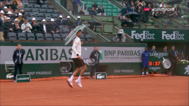 VIDEO: Djokovic borrows fan's umbrella for some fun in the rain
